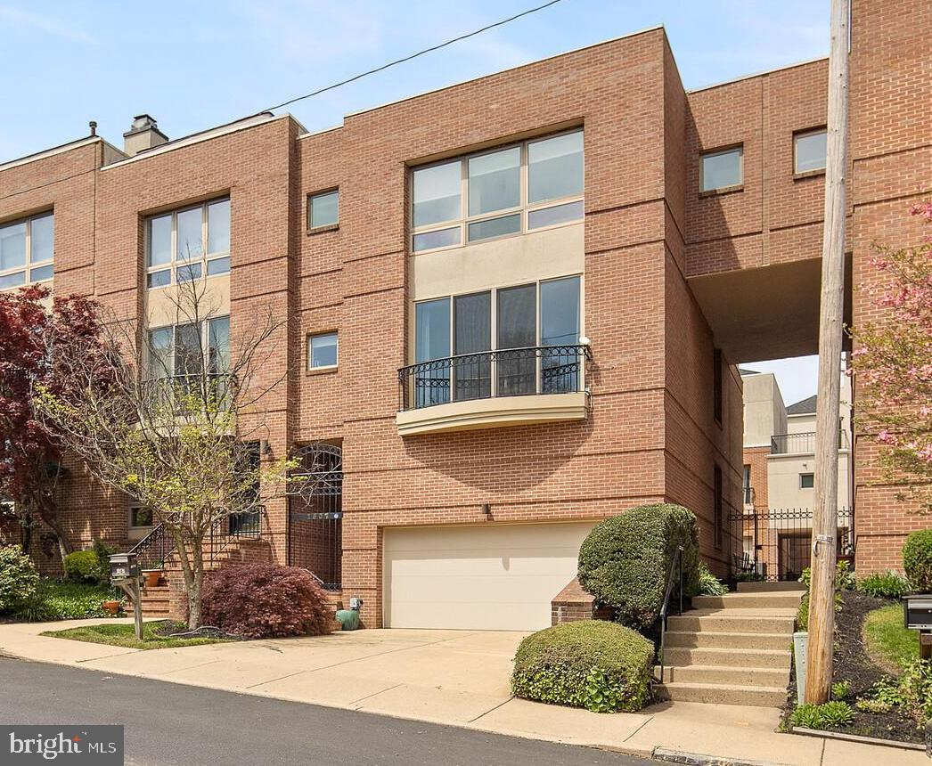 Come fall in love with this absolutely stunning townhome in desirable Westhill. This gorgeous home boasts every update you could desire, and more! Enter through private gaited entrance or through the two car garage into the first floor. This floor features new ceramic flooring, a bathroom and entertainment area. Upstairs to the second floor features a spacious open concept kitchen and living room. The kitchen features a stunning quartz kitchen island, granite counter tops, large subway backsplash, a gourmet hood and stainless steel appliances. The living room and kitchen are connected with the wet bar, that is complete with granite countertops, open shelving and a mini fridge. Enjoy the views of the Brandywine park that the large window and balcony over look.  This beautiful view is also shared upstairs with the master bedroom. The master bedroom has vaulted ceilings,  two large custom closets and remote controlled blinds, just in case you want to sleep in.  The  generous en-suite has beautiful tiling, dueling sinks,  jacuzzi tub, and a spacious shower.  This home truly leaves nothing to be desired, you might as well bring your bags to your tour because you will not want to leave!