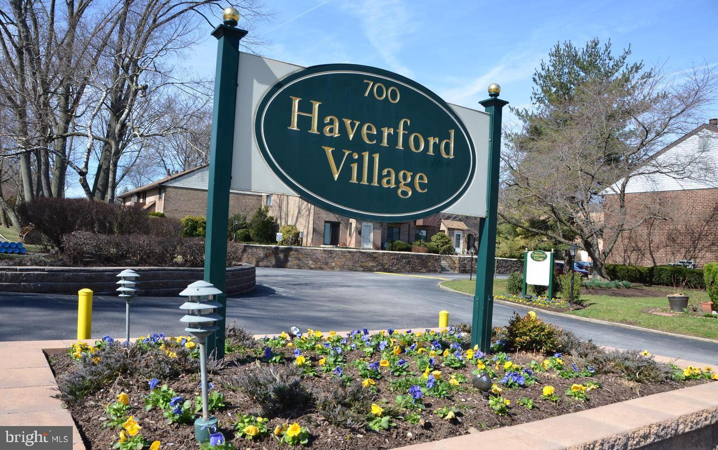 You won't be disappointed with this 2 story, 2 bedroom, 2 full and 1 half bath condo-townhome in  desirable Ardmore in the conveniently located Haverford Village and the highly rated Haverford Township school district.  The first floor of this home features a  foyer with coat closet; spacious living room with gas fireplace and sliding glass doors to private patio;  formal dining room that is open to the kitchen with wood cabinets,  electric stove, dishwasher and small breakfast bar;  laundry room with washer/dryer (included as is) and convenient powder room.    The second floor features a large main bedroom with  sliding glass doors to a deck, walk-in closet, ceiling fan and attached bath with stall shower;  second bedroom with attached  bath with tub shower;  a hall linen closet  and storage closet complete the second floor.  Additional features: low HOA fee to include outdoor community pool, lawn maintenance, common area maintenance, snow removal, trash collection and water; convenient location close to Nature Trail, Haverford College, Elwell Playground, walking distance to public transportation, restaurants, shopping and so much more!! Make your appointment today!!