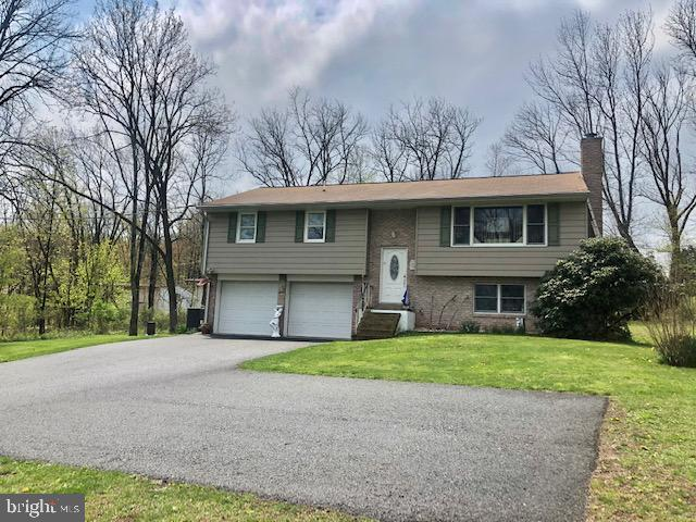 Welcome to 951 Swinehart Rd. located in the Boyertown SD. This gorgeous 3 Bedroom 2 full bath Bi-level recently painted with neutral colors sits on 1.83 Acres with a partially wooded lot and close to major routes. Totally re-done with top-quality workmanship throughout !!! Just to mention a few items, all new windows, doors, crown molding, and flooring thru-out. A new kitchen sporting beautiful cabinets with granite countertops and Island. The finished lower has a full bath, laundry, stone wall with fireplace, and has access to a backyard that will make entertaining with family and friends a pleasure.   Sit out on the patio or on the maintenance-free trek deck and enjoy the sounds of nature. All new appliances remain. This home qualifies for 100% financing, call for details and your personal tour today.