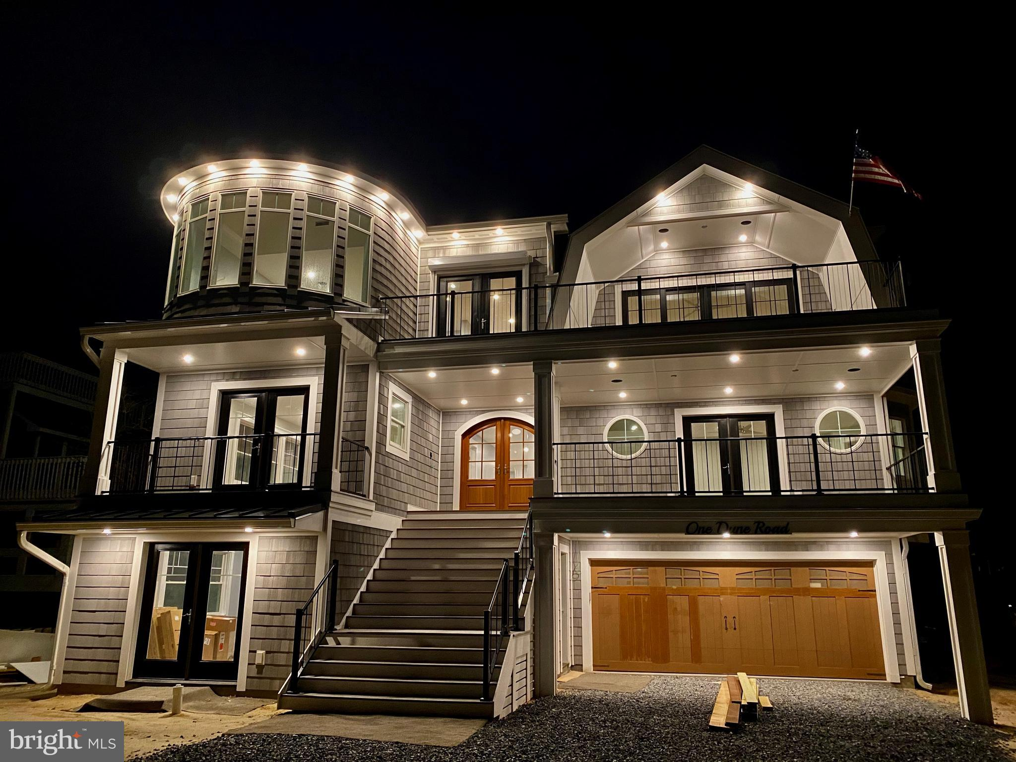 Welcome to beach living at its finest.  This elegant 6 bedroom home, nestled in Bethany's private Middlesex Beach ocean-front community, is built with the highest quality craftsmanship, upscale design, and smart technology.  This collaboration between a local designer and builder, brings a personal touch to this custom, one of a kind home.  The deliberate combination of creativity with meticulous attention to detail and exacting standards is truly stunning.  Brazilian sourced Massaranduba wood decks on all levels provide entertainment and relaxation space and  fabulous water views abound.  Perfectly suited for family gatherings or elegant entertaining, the main level includes a great room with a gas fireplace, dining room, wine cooler, gourmet kitchen featuring a large island, breakfast nook, two SubZero refrigerators, 2 two-drawer dishwashers, separate pantry, and grilling deck.  6 over sized en suite bedrooms include a bunk room with custom queen /double beds and built in cabinetry.  Two laundry centers, a theater / gym, 2nd living room with wet bar, fridge and microwave, elevator, and 2 car garage with electric car chargers, and dual outside shower rooms complete the home.  Enjoy spectacular Panoramic views of the Atlantic Ocean with inspiring sunrises and spectacular sunsets from the spacious skydeck.  Delivery 2nd Quarter 2021.