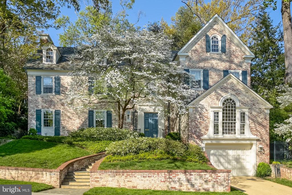 OPEN SUNDAY 1:00-3:00.  Known for its elegant and stately homes, Massachusetts Avenue Heights has long been the frequent choice of the international diplomatic community and prominent private citizens. Georgian in style,2829 Woodland Drive has a broken pediment over the front door and other Georgian embellishments like the Palladian window over the garage, echoed in the dormer windows. This distinguished property is close to downtown DC, The National Cathedral, convenient shopping areas, restaurants and Reagan and Dulles Airports. About one mile to the nearest Metro red line stop, the area is also served by buslines for downtown commutes.  From the moment you enter this beautiful Georgian home, you are immediately drawn to the graceful spiral staircase, the large formal dining  room, the exquisite double living room and a sunroom with an elegant Palladian window.  The gourmet cook's kitchen has a Wolf six-burner cooktop and double oven, SubZero side-by-side refrigerator, SubZero mini drink refrigerator, Bosch dishwasher, Israeli granite countertops and French doors leading to a charming tiered garden.  The second and third levels offer a master bedroom suite, office, den and four additional bedrooms.  On the lower level, there is a sizable family room, laundry room, a climate-controlled wine cellar and an abundance of storage space.  Elevator from lower level to second floor.  French doors in each room across the rear of the house lead to a luscious terraced garden extending clear to McGill Terrace. VIDEO TOUR: https://vimeo.com/541440672