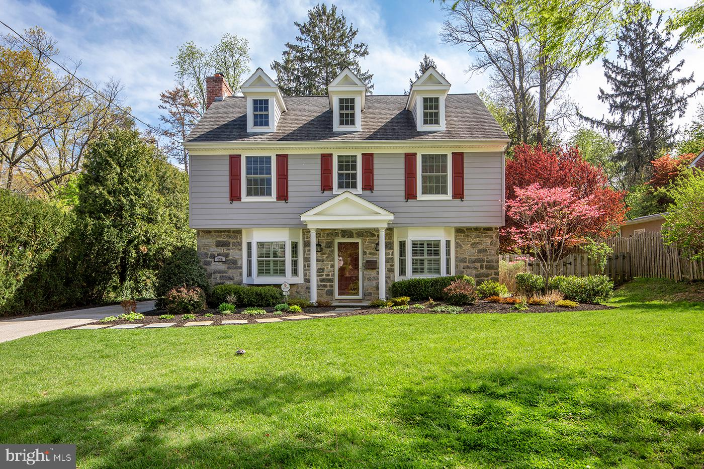 Experience the charm of a traditional stone colonial enhanced by a total renovation, modern open floorplan, and wealth of luxury upgrades! This exceptional Wynnewood family home on beautiful grounds is ideally located in a fabulous neighborhood near it all. Before current owners purchased this gem it was impeccably renovated by a prominent builder known for quality craftsmanship and attention to detail. Among the improvements that have enriched the home is a 30-year Certainteed architectural shingle roof; deep silled double-paned windows with energy-efficient low-e glass; gorgeous site-finished oak wood floors; exquisite moldings, millwork, hardware & fixtures; tastefully redone baths; and a thoughtfully-designed kitchen with custom cabinetry, granite countertops, and premium appliances for the chef.   Even more recent upgrades include the partly finished basement, window treatments, beautiful landscaping, an expanded patio, storage shed, and leveled backyard that is quiet and spacious.   Interiors are elegant and comfortable with sunlight pouring through. The main level has an easy flow for entertaining and gracious backdrop for relaxing with loved ones. Cozy up around the wood-burning fireplace in the living room with a book, board game, coffee or cocktail. Share family dinners and host holidays in the lovely dining room. Gather in the true heart of the house, the kitchen/breakfast/family room area, for cooking, casual meals, watching movies, or just lounging together.   Plus there's so much else to love, like a family room fireplace; convenient mudroom that's always an essential; an inviting master suite with a custom walk-in closet and tiled bath; junior suite with walk-in closet and private bath; 2 bedrooms adjoining a Jack and Jill bath; 2nd floor laundry; and 2 powder rooms. Kids will love spending time on the lower level with lots of space for play/recreation, as well as shelving and storage to keep things tucked away.  Topping the appeal is the address that