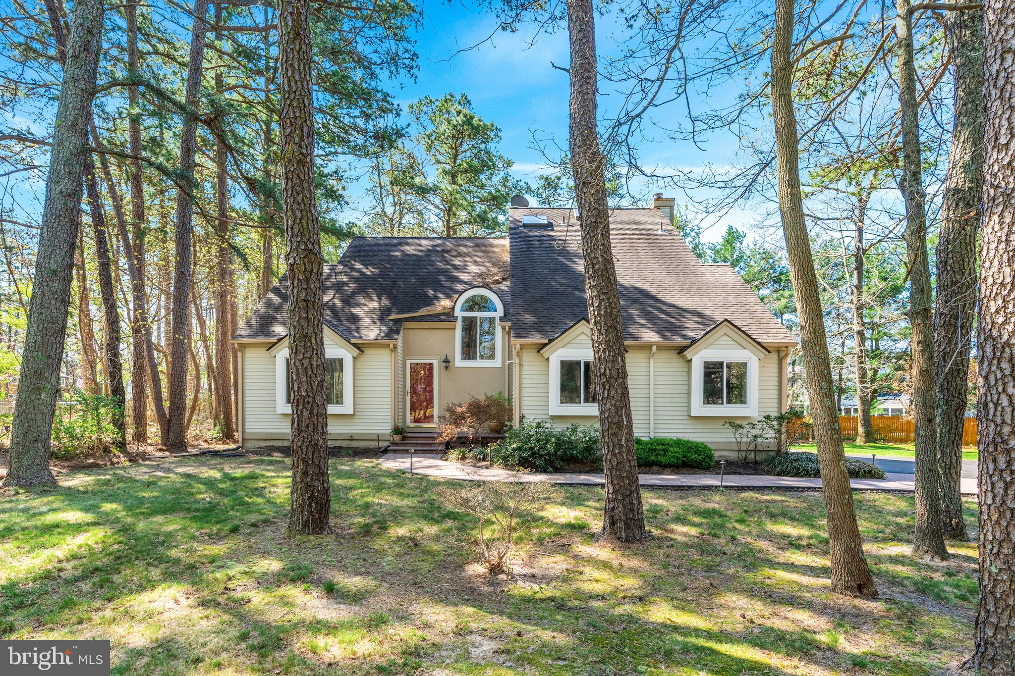 This picturesque transitional/contemporary home is comfortably nestled in the tall trees within a friendly neighborhood of similar homes.  The home is so approachable and inviting, welcoming you from the moment you pull into the driveway.  There's a deep setback from the street and that means you'll enjoy privacy which also extends into the rear yard.  There's a large custom, wrap around deck off the rear corner of the home and a short staircase leads to a ground level deck with a custom paver firepit ready for you to enjoy long evenings entertaining and relaxing.  The home also includes a full custom cedar storage shed and ample grassy areas for the children and pets to play. A paved driveway leads to a 2 car side turned garage, so you'll never have to worry that there's enough parking for family and guests alike.  A EP Henry paver walkway and front stoop invite you to come inside and experience the comfortable and open floor plan.  High ceilings and hardwood flooring receive lots of natural light from the abundance of well positioned, newer windows, throughout the home.  Everything has been freshly painted in soft on trend colors while white painted wood trims add a fresh finish. The stair railings were recently upgraded with wood railings and decorative iron spindles. The kitchen is a real beauty with wood cabinetry, a farmhouse sink,  granite countertops, stainless steel appliances (Bosch Range and Dishwasher), stainless vent hood  and a decorative marble tiled backsplash for the perfect finishing touch.  While you're here, make sure to take notice of the pull  out pantry drawers, deep drawers for pots &  lazy Susan. Recessed and pendant lighting assure you'll have a well-lit workspace .   One of the greatest features of the home is the adjoining Family Room with  hardwood flooring, a cozy gas fireplace and a flexible layout for use as combination casual Dining/Family Room.  From here you can easily move outdoors & extend the party space to the  deck and yard. T
