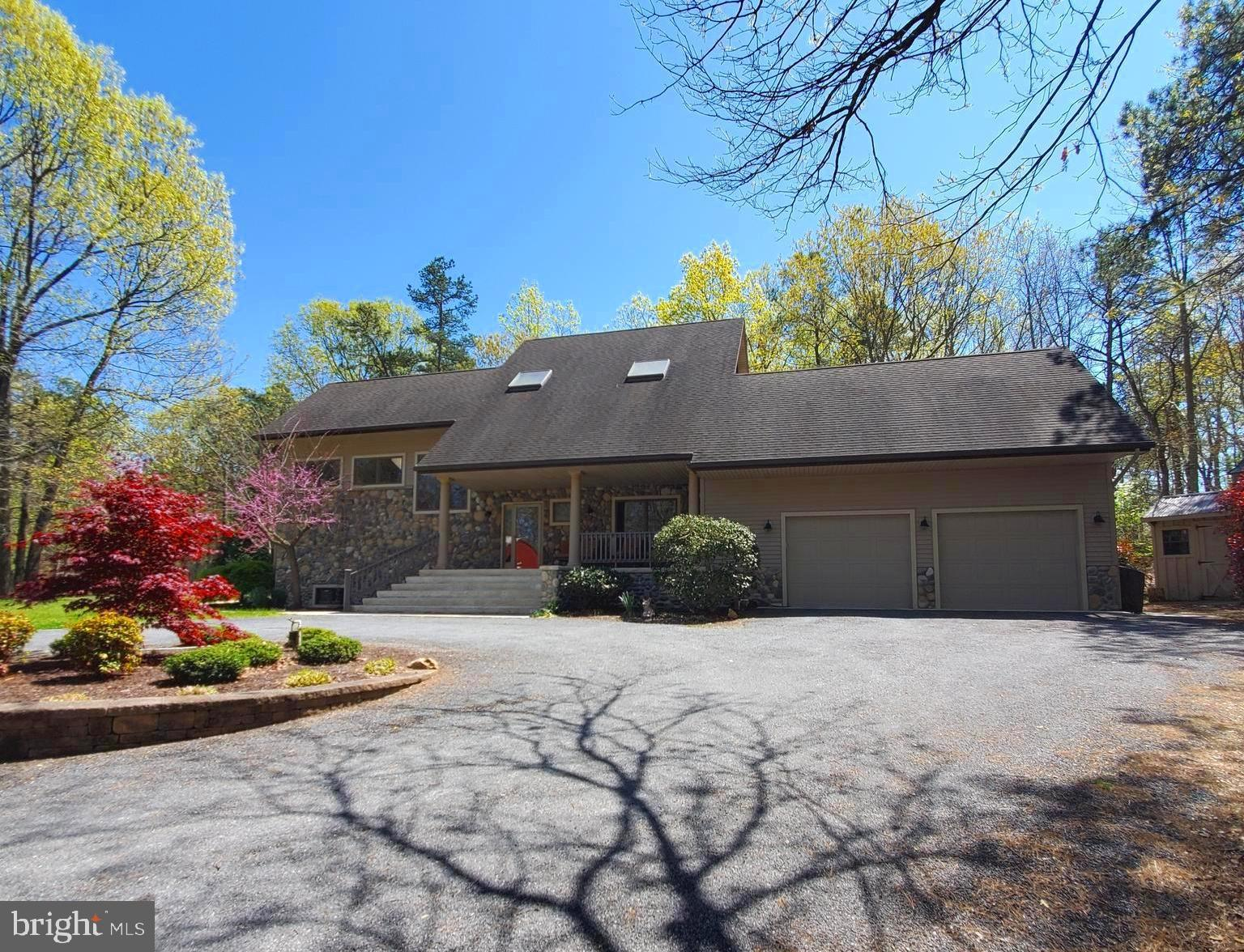 Lovely custom built contemporary 2 story, located in Alloway Twp.  Open floor concept, recessed lighting throughout, oak hardwood floors, tile and carpet.   Sunroom with radiant tile floor heating.  Living room with beautiful atrium windows and highly efficient wood stove open to dining area.  Beautiful, large Anderson windows throughout the home providing an abundance of sun light.  Master suite on first floor with large walk-in closet leading to master bath and bedroom.  Laundry on main floor.  Loft on second floor leading to 2 bedrooms and a full bath which boasts a 6 foot shower tub.  Ceiling fans throughout.  Meticulous custom Beadboard ceilings.  Ash wood custom cabinetry in kitchen and baths.  Accessibility features such as wide doorways and ramp.  Full basement built with Superior walls. Hardscaping around home leading out to the back yard.  Steel barn with three stalls and ample room for hay, tractor(s) or car(s).   Small fenced in pasture area.  Gutter guards on home and out-building.   The wooded area has nicely cleared paths for horse back riding and recreation. Make your appointment today!