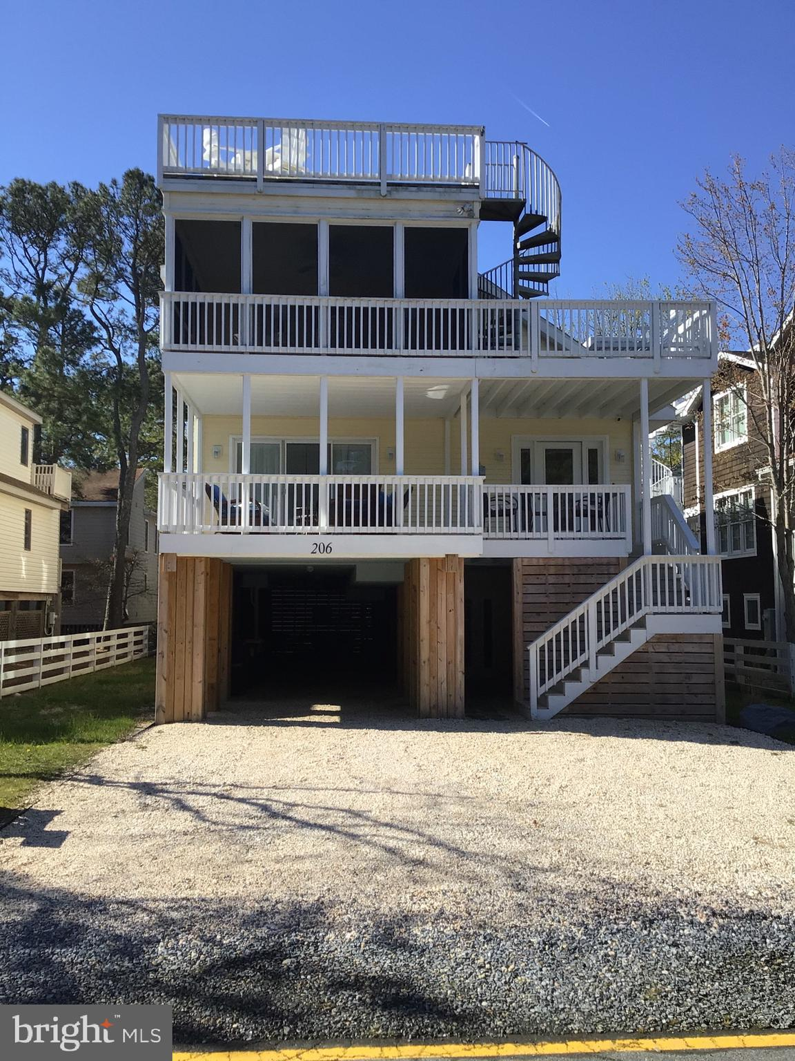 One of Bethany's best rentals. Great investment! Updated home in downtown Bethany Beach 2 and 1/2 blocks from the beach and boardwalk. House has spacious parking underneath as well as 2 driveway parking spots. Home is 3 levels with covered porches and a rooftop deck.  Property has proven to be an exceptional rental, but ready for year round living. Under the house is a game room with seating, a large picnic table, great for crab dinners and a large outdoor shower. Entrance has a half bath. Second Floor has living room, kitchen, laundry, dining area and 3 bedrooms and 2 full bathrooms.  The third floor has an additional living room with a sleep sofa, 3 bedrooms and 2 full bathrooms. A spiral staircase from the 3rd floor leads to the roof top deck. The home comes furnished, ready for move in. Rental agreements must be honored.