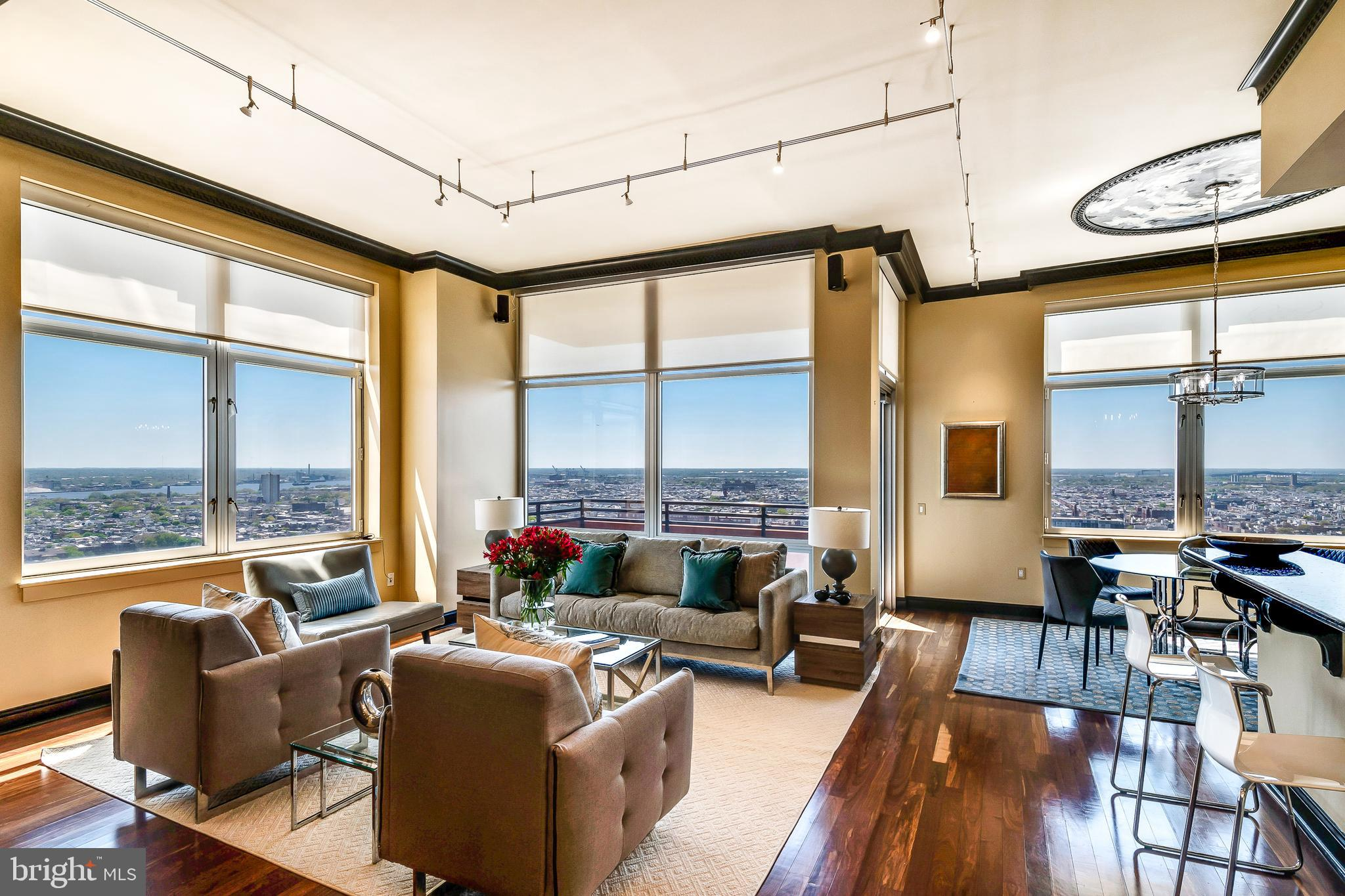 This stunningly elegant two bedroom, 2.5 bath residence gifts simply inspired views from the soaring 28th floor of prestigious Symphony House. Offering a rare expanded corner floor plan and seamless open concept living, Suite 2804 is ideal for those seeking more expansive live space and the gracious room to entertain. The entry gallery with tray ceiling makes an immediate statement upon entering the residence, as you are struck by the lofty 12' ceilings and an abundance of natural light.  The main live space is flanked by oversized windows framing a breathtaking city, bridge, river and Avenue of the Arts panoramic.  Step onto the private balcony for fresh air and sunshine, a morning coffee or evening glass of wine at sunset.  Anchoring the opposite end of the main live space, a gorgeous custom built-in wall that is as functional as it is beautiful.  Stylish crown molding, floor to ceiling windows, hardwood floors, and custom window treatments.   An expertly-fitted urban galley kitchen boasts stainless Viking professional appliances, granite countertops, a wine chiller, custom-fitted walk-in pantry, and stylish backsplash.  The private master suite is bright and spacious with an expansive fitted walk-in, large secondary closet, and moderne bath with dual sink, oversized shower and custom cabinetry and lighting.  On the opposite corner of the residence sits a dramatic guest suite with commanding river views that will catch your breath, adorned with  wonderful built-ins perfect for a transitional home office.  The guest suite also offers a private en-suite bath and plentiful closets.  A simply beautiful, highly-coveted residence, and an exceptional opportunity. Two garage spaces in the building's private garage and a storage locker are included with the residence. Offering unparalleled services and amenities, prestigious Symphony House is the city's premier Avenue of the Arts address boasting 24/7 concierge and doorman, 65' heated indoor lap pool, steam and sauna, stat