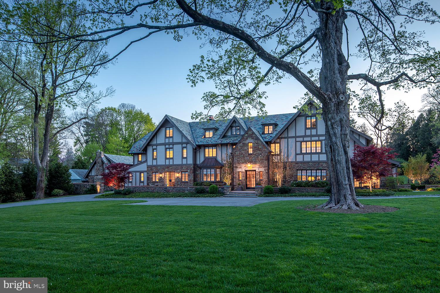 With breathtaking views of the 15th fairway of the famed Merion Golf Club, this stately English Tudor has recently been renovated, expanded and is exquisite inside and out.  Positioned on 2.24 acres, its stone walls and lit entrance piers at both Golf House and Andover Roads welcome you home.  The property comprises a grand main residence with 6 bedrooms, 5 full baths and 3 powder rooms, and separate carriage house with a 5-car heated garage and 2-bedroom apartment above. On the sprawling estate grounds you'll enjoy a sparkling pool with spa; flagstone patios for entertaining; and a new pool house with stone exterior, covered patio, masonry fireplace, full kitchen with bar counter, laundry and full bath.  Every inch of this jewel was considered by the owners in its no-expense-spared renovation and expansion. Thoughtful enhancements include an added parking area; rebuilt front veranda; extensive landscaping & exterior lighting; new and refinished windows; new custom French doors; refurbished slate roof; rebuilt chimney with new liners; new entry columns; and new copper roof & gutters on the family room and side entrance additions. All systems and mechanicals are also top of the line, from new plumbing and electrical to high-efficiency Geothermal HVAC; new hot water heaters; and an Elan smart system in the main and pool house for interior/exterior lighting, music & media controls.  Plus a new 38K BTU Kohler generator is on standby to power the entire main residence and garage doors in the event of an electrical outage. Gracious interiors received the same attention to detail and offer every luxury amenity. Among them is a new elevator accessing 3 levels; all new recessed lighting controlled by Lutron Home System; radiant heat flooring in the entry foyer, rear hall, family room and master bath; and a stunning new custom chef's kitchen with Waterworks cabinetry, a huge island, custom hood/ventilation system, and full suite of premium Gaggeneau, Sub-Zero & Miele professional appliances. Elegant remodeling continues in the generous living and dining rooms with fireplaces, bedrooms and baths, laundry room, home command center, and entire 3rd level play area which includes two full baths, and two bedrooms, one with three cabin-style platform beds for the kids. The breakfast room, gourmet kitchen and adjacent vaulted family room offers custom windows on three exposures and an easy indoor-outdoor flow through glass doors. A handsome library with fireplace flanked by built-in cabinetry provides a perfect place to read, relax and work. Well-proportioned bedrooms await upstairs for family and guests. The highlight is the luxurious primary suite with a spacious dressing room, custom closets, and spa bath with his/her vanities, a freestanding soaking tub, oversized shower, and water closet. The lower-level extends the living with a large-screen media room with beamed ceilings and gas fireplace, and cards/game area with full bar. Incomparable views of the renowned Merion Golf Club, and a prestigious address near all conveniences heighten the allure.