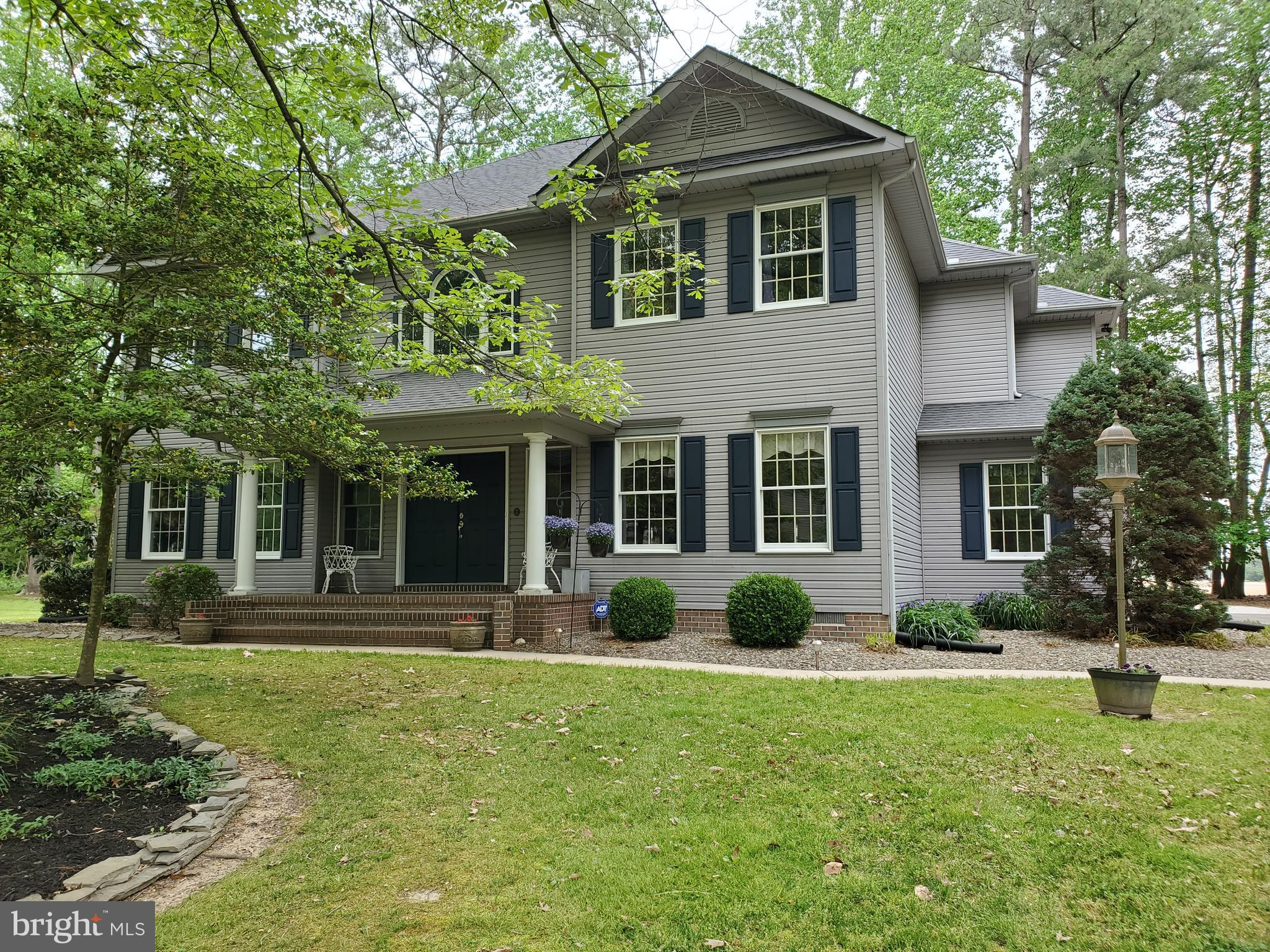 This large beautiful Georgian/Colonial home is ready for a new owner.  If you are a traditional person and love real hard wood flooring and need formal living and formal dining than this home is what you have been waiting for.  This home boast real hard wood flooring on the entire first floor, up the steps and in the hall way upstairs.  The kitchen has stainless appliances, pantry cabinet and pantry closets, wall oven, beautiful views from the windows and eating bar for 5 with a space for a kitchen table and is open to the 20 x 17 family room that opens to the patio.  The primary bedroom is your own personal retreat: from the private sitting room, walk in closet, sliding doors that open to the 2nd floor balcony and the master bath with walk in shower, jetted soaking tub, double sink, and water closet.  That is a fine way to end your busy day.  The other bedrooms are large in size and offer more that just a place to sleep.  The exterior of this home has trees and landscaping.  The 3 car garage is oversized with plenty of storage areas.  The patio out back has a hot tub and decorative fencing.  There is even a Golfer green for practicing your swing.  This home has everything for the person that is retired and needs some at home activities, to the had working person that needs to unwind after their long day.  The charm of this home is very inviting and warm feeling.   Call today to see this home!