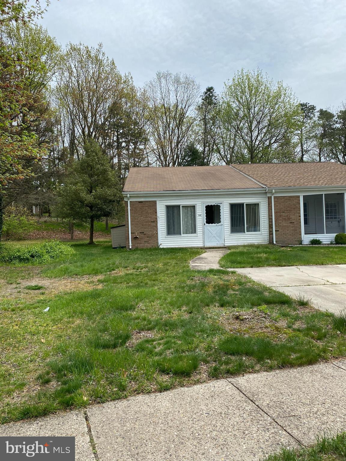 Berwyn - End Unit  Being Sold in AS IS Condition - Home Inspection is for Buyers Information Purposes Only Newer Double Pane Windows and Patio Door. Enclosed front porch On an eyebrow that Backs to Woods Why Rent when you can buy this Unit. Won't last long schedule your appointment today.