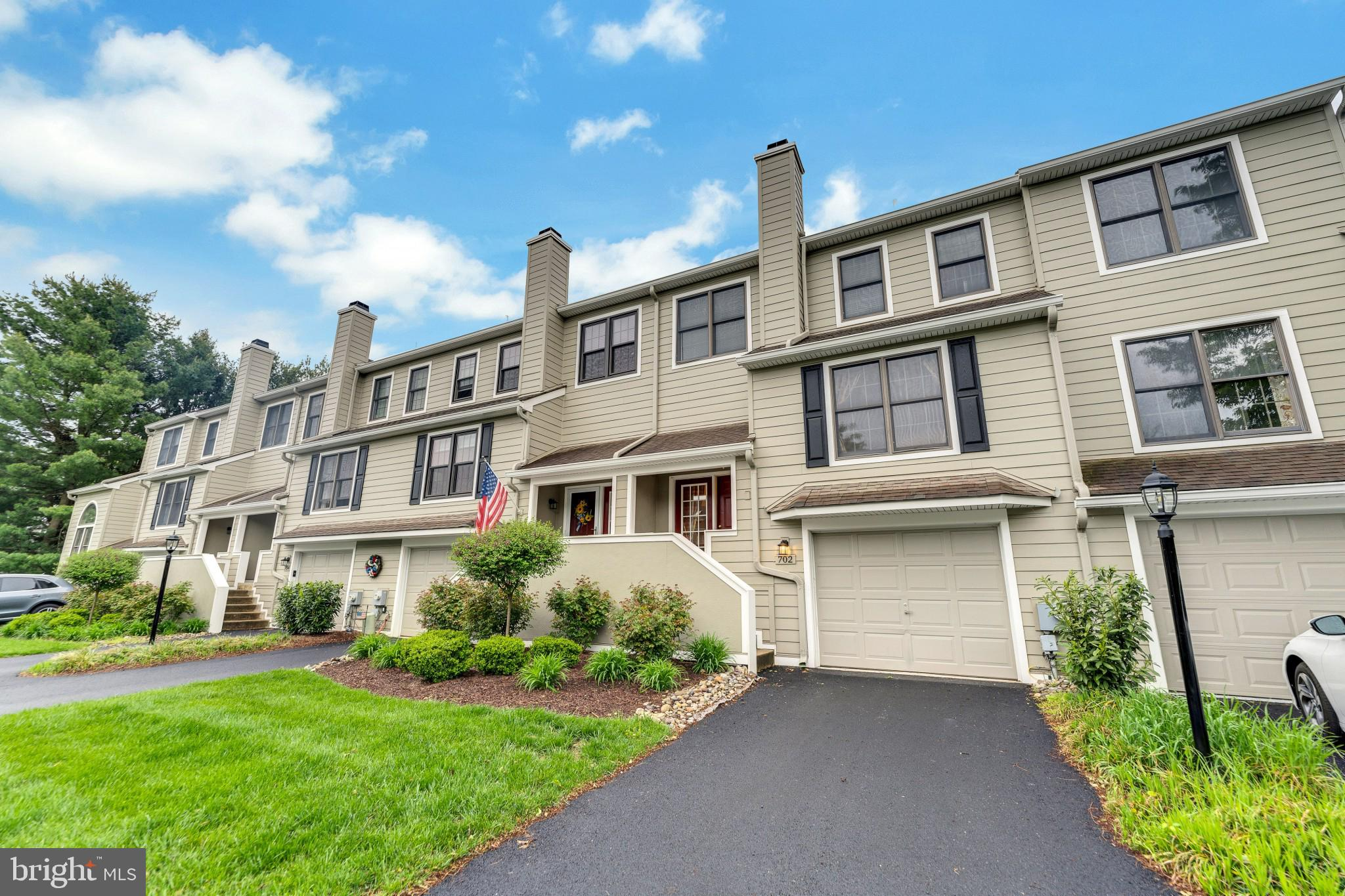 Welcome to 702 Radcliffe Court, a beautiful 4 bedroom, 2.5 bath townhome located in the Willistown Knoll community in sought after Newtown Square. One of the largest units in the whole community. Chester County Schools including the highly rated Sugartown Elementary and Great Valley Schools. Willistown Knoll is spread over about 200 acres of lush green spaces with manicured landscapes shared by about 200 homes. Large open areas throughout the development. You can enjoy about 2.2 miles of peaceful walk/run in the development protected from traffic everyday.  Enjoy open concept living on the main level with an expansive living and dining room area, a warm wood burning fireplace, beautiful chair rail and crown molding that continues into the kitchen. Inviting kitchen boasts hardwood floors, double sink, recessed lighting, tile backsplash, breakfast bar and a sun-drenched breakfast room with french doors to the wooden back deck.  Enjoy warm summer days outside on your deck enjoying your morning coffee or entertaining friends and family.  A powder room with hardwood floors completes the main level.  Stairs to the upper-level lead to the large master bedroom with crown molding and a large en-suite with double sink, soaking tub, shower stall and tile floor.  Three additional bedrooms, a full bath and hallway linen closet can all be found on the upper level.  Lastly, the lower level has been finished to offer additional living space with a dry bar and an unfinished area, perfect for all of your storage needs! Parking in the driveway for 1 car, 1-car attached garage and up to 5 additional parking spaces available in the common parking. Large size garage with ample opportunity for storage. The Willistown Knoll association takes care of all of the external maintenance, roofs, lawn care, snow removal including that on your steps and driveways, and landscaping.  Perfect setting with 3 minutes car drive to the popular 180-acre Okehocking Preserve with its meadows, rolling hills, 