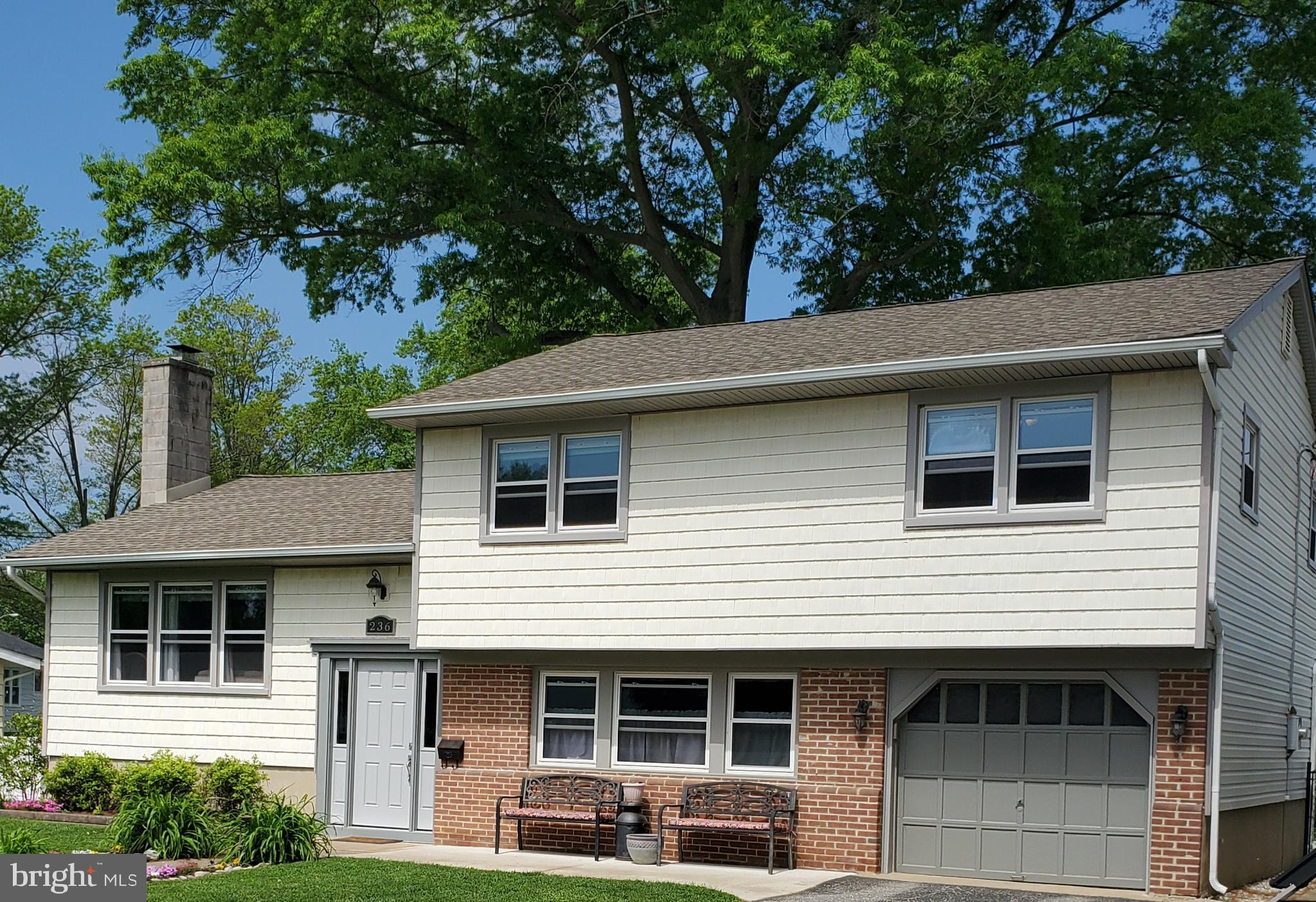Welcome to your new home! Located in beautiful Woodstown Borough, this attractive split colonial has been loved and well taken care of.  Enter at main level into the family room to drop your bags and jackets which also leads to laundry, half bath, rear yard entrance and garage entrance. Come into the nicely sized living room to relax on those cozy winter evenings in front of the brick wood burning fireplace. This area is open into the formal dining room. The kitchen offers a stainless appliance ensemble along with ample room and counter space for preparing those family gatherings.  Step up to the hallway leading to four generously sized bedrooms, also boasting hardwood flooring.  The backyard is all fenced in, and offering a nice cemented area for recreation.  Roof &  hot water heater - 2014.  Electrical Panel - 2015. Rear yard fencing 2016. Refrigerator, washer/dryer - 2018 - You will be pleasantly surprised by this lovely and inviting home, make your appointment today!