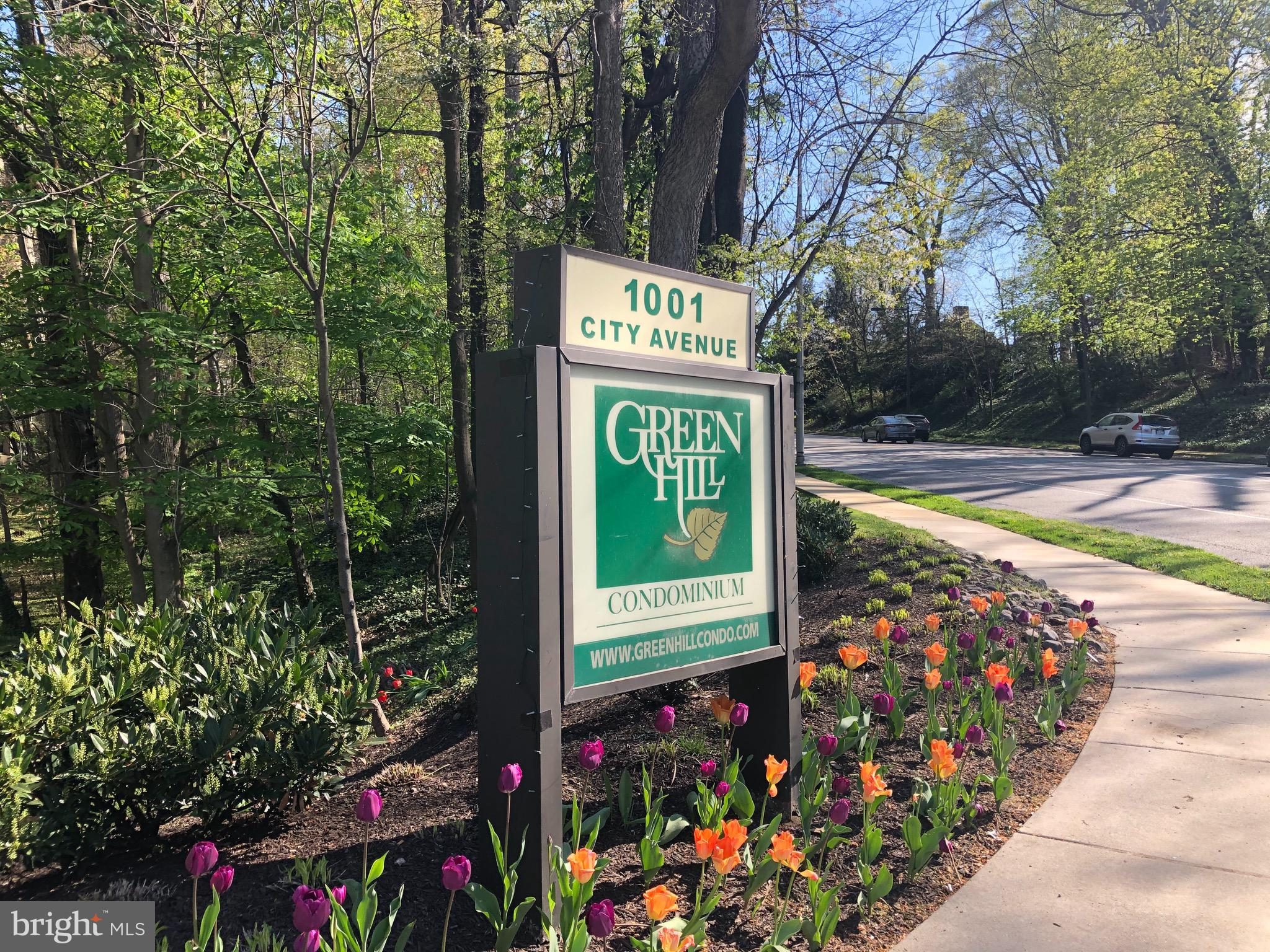 UPDATED AND LOVELY 2 BR, 2 BA UNIT IN THE GREEHHILL CONDO, A PREMIER LIVING EXPERIENCE ON THE MAIN LINE, JUST OUTSIDE THE CITY OF PHILADELPHIA, IN THE COVETED LOWER MERION TOWNSHIP. THIS UNIT HAS BEEN UPDATED AND CARED FOR BY THE CURRENT OWNERS DURING THE PAST 10 YEARS. NEWER KITCHEN AND BATHS, BEAUTIFUL HARDWOOD FLOORING EVERYWHERE EXCEPT MASTER BEDROOM, WHICH HAS FRESHLY CLEANED NEUTRAL CARPET. THE WALL HAS BEEN TAKEN DOWN BETWEEN THE KITCHEN AND DINING ROOM, OFFERING A SPACIOUS AND OPEN FEELING. NEWER APPLIANCES. WINDOW TREATMENTS ALL REMAIN, AS WELL AS THE BEAUTIFUL DINING ROOM CHANDELIER. THE SECOND BEDROOM WHICH HAS POCET DOORS FOR PRIVACY CAN BE USED AS A DEN OR OFFICE AS WELL AS A BEDROOM. ABUNDANT CLOSETS AND BASEMENT STORAGE LOCKER. THE GREENHILL OFFERS AMENITIES FOR A FEE SUCH AS A BEAUTIFUL OUTDOOR POOL AND HEALTH CLUB. INDOOR PARKING AVAILABLE FOR A FEE. FULL 24 HOUR  SECURITY AND A SECURITY GATE OFFERS COMPLETE PRIVACY TO RESIDENTS. CONDO FEE MONTHLY IS $872.  2 MONTHS CONDO FEE PAYABLE AT CLOSING. THERE IS A SPECIAL ASSESSMENT OF $1021.25 PAYABLE IN 3 INSTALLMENTS-JUNE ,JULY AND AUGUST, $340.42 PER MONTH MOVE IN FEE: $500 (REFUNDABLE), ELEVATOR FEE: $150 (NON REFUNDABLE)