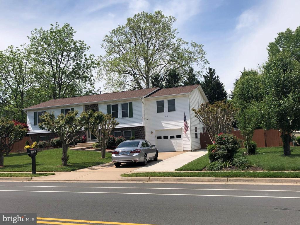 Very well maintained house with renovations. New wooden floors in the basement placed in April 2021, 2 master bedrooms, Air conditioning installed in 2019, refrigerator and kitchen installed in 2019, the roof recently installed in 2020, front door and back door in 2020, garage door with system set in 2020, washer and dryer connections and a 2nd kitchen as optional. Wonderful neighborhood with schools and shopping centers close to the property. Send your best offer.