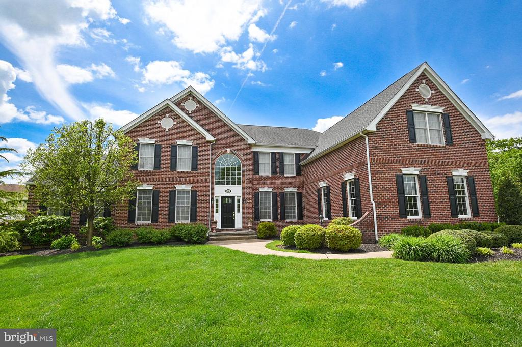 Exceptional, Grand Brick Front Colonial on level cul-de-sac lot only available due to seller relocating.  Huge rooms, lots of windows for wonderful natural lighting throughout the home.  All windows on first and second floor have been replaced within the last year, this includes all entry  doors.  A new roof is being installed on May 25.  Wood floors, gorgeous gourmet kitchen, solarium, sunroom, first floor office, family room with wall of windows.  Walk up basement, 3 car garage, totally fenced rear yard with handsome black aluminum fence, back staircase, main floor laundry, abundant custom moldings throughout.  This home is conveniently located near shopping and major roads but offers the peace and quiet of a country setting.  Showings begin Friday May 14, additional photos expected on 5/11, don't miss this beauty it is exquisite.