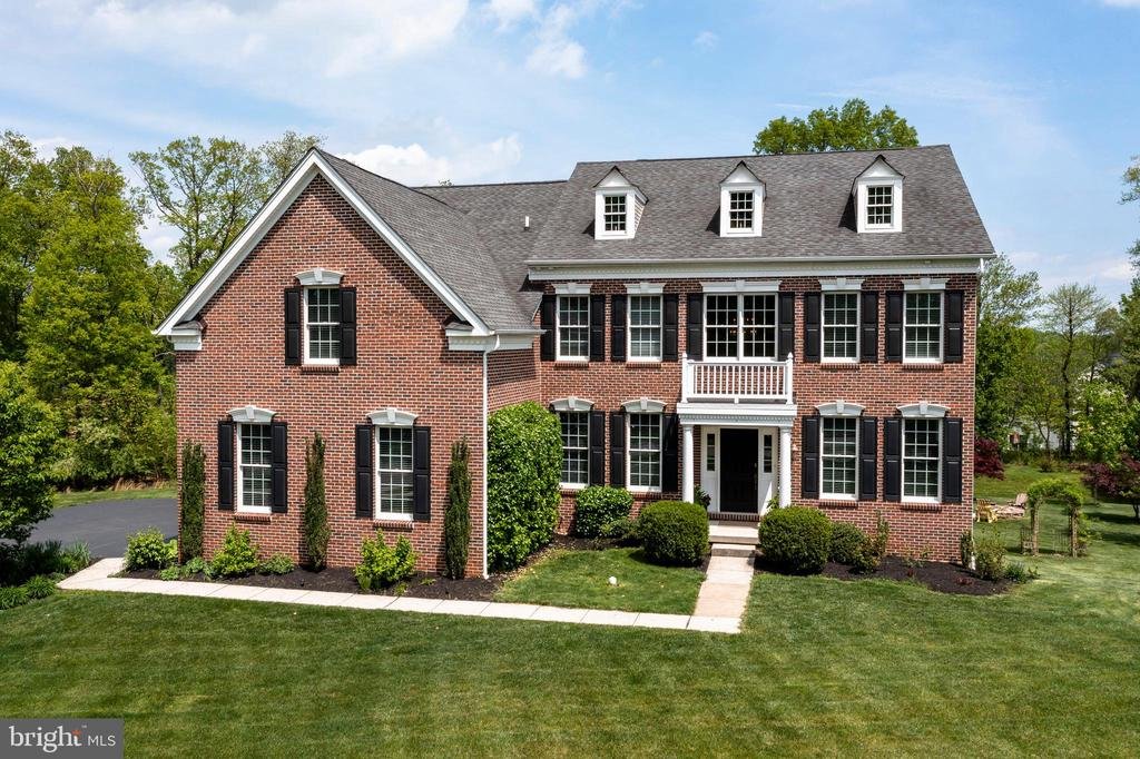 MAGNIFICENT 5 Bedroom, 4.5 Bath brick front Colonial ideally situated on a prime lot in the prestigious Chestnut Ridge Estates in Top Rated Downingtown Area School District and STEM Academy! Grand 2-story hardwood Foyer entry is flanked by the Dining Room with tray ceiling and the Living Room, both embellished with crown molding, chair rail, detailed woodwork adorning the openings, and new hardwood floors. Enjoy the open and airy feeling of the spacious, 2-story Family Room with recessed lighting and ceiling fan, anchored by a wall of windows and marble surround fireplace. Continue into the sprawling gourmet eat-in Kitchen with hardwood flooring, quartz counters with tiled backsplash, stainless steel appliances and an abundance of cabinetry with large center island that offers additional storage and seating, Breakfast Nook with updated lighting and Morning Room with bright, natural light flowing through the many windows and skylights. The French door exits to the expansive composite deck that conveniently offers afternoon shade, perfect for entertaining and a staircase to the rear yard. The First Floor Study with lighted ceiling fan, Powder Room, Laundry Room with cabinetry and utility sink, rear Staircase to the second floor and exit to the 3 Car Garage complete the First Floor. Retreat upstairs to the Master Suite sanctuary with Sitting Area with crown molding and lighted ceiling fan; Master Bathroom with vaulted ceiling, platform soaking tub with large picture window backdrop, Huge Walk-in Closet, thoughtfully separated into two separate spaces; and Bonus Room with ceiling fan, perfect for Office/Craft Room/Home Gym. The Second Floor also offers a delightful Princess Suite with Full Bath and walk-in closet, a separate suite area with two nicely sized Bedrooms that share a Full Bath. All bedrooms feature lighted ceiling fans. The finished Lower Level was well-designed and offers additional entertaining and living space with a Recreation Room with wet bar, 5th Bedr