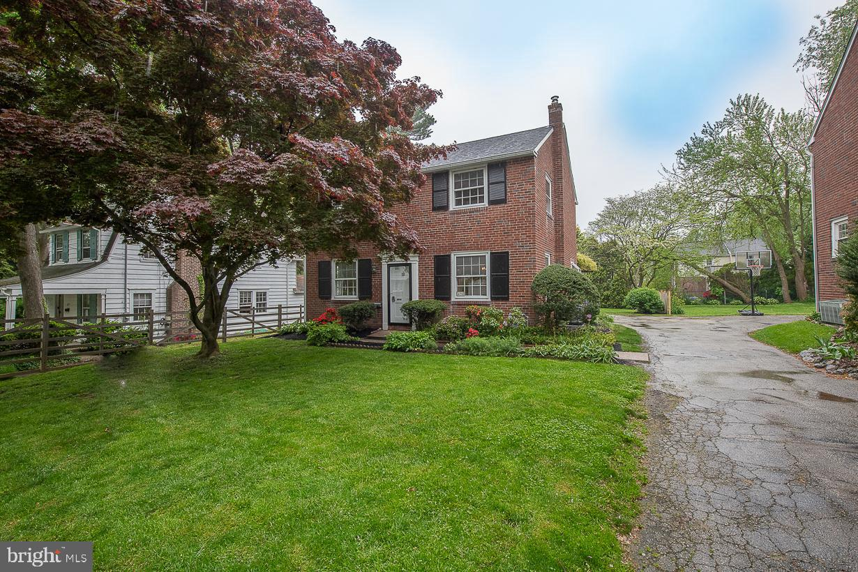 Welcome Home! Highly desirable brick single home in Ardmore Park/Haverford Township. Friendly and walkable neighborhood close to parks, transportation, shopping/Suburban Square, and more.  The first floor boasts a large sun-drenched living room and dining room with a custom built-in corner cabinet and refinished hardwood oak floors. The kitchen has solid wood cabinets, a new gas stove and microwave, a garden window, and ample storage. The newly renovated family room features a custom brick gas fireplace, recessed lighting, and large picture windows. A large sliding door accesses the connected screened-in porch including a drop-down table and ceiling fan. Two porch doors access a garden lover's back yard and fishpond as well as a wisteria-covered pergola that is 50+ years. The fish pond is opened up for the season and ready for you to enjoy the relaxing sounds of the stream and colors of the goldfish.  The bright second floor has 3 bedrooms: a master with 2 generous closets, and the second and third bedrooms each with their own. The bath is tiled and accessible to all. From the hall, there is a door to a spacious sundeck. Attic access is from the second bedroom and allows for additional storage. Hardwood floors throughout.  New HVAC. New Roof. New fencing. Full basement with laundry and utility sink. Come see and fall in love today!