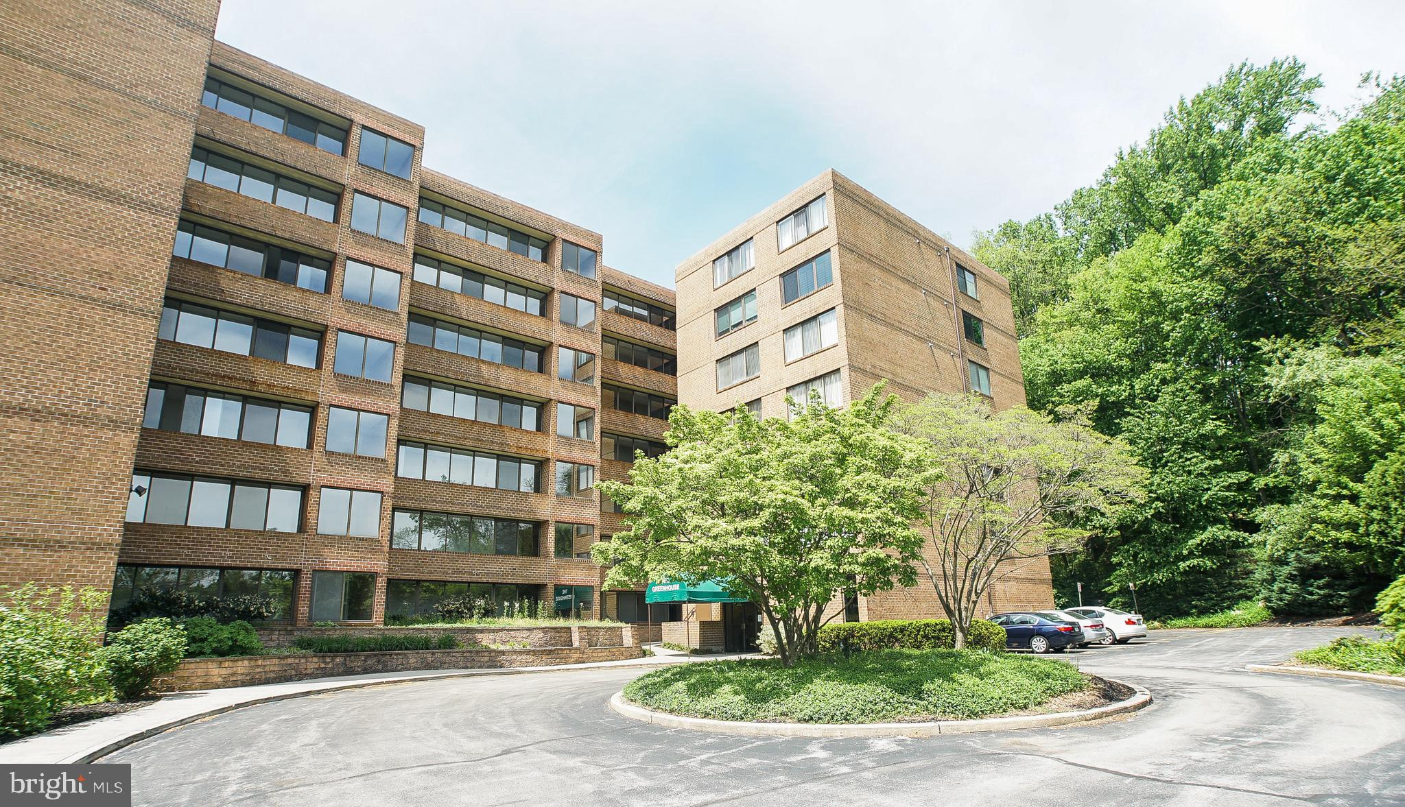 Gorgeous condo located in the popular Greenhouse Condominium Community in Lower Merion School District. This unit is impeccably maintained. It was a 2 bedroom unit but the second bedroom was converted to a spacious master bedroom suite! An added plus, the master bedroom space could be converted back to a two bedroom if so desired! This exceptional and bright home features many amenities including hardwood floors throughout, tiled floors in bathrooms, a gourmet kitchen with granite counter tops, granite center Island, oak cabinetry, tiled backsplash, under and above cabinet lighting and new stainless steel appliances. Across from the kitchen is a living room and dining space, with large windows letting in plenty on natural light. The master suite also contains an updated bathroom, upgraded walk-in closet and a sitting area, and access to a spacious balcony. The hall bath also features a washer/dryer combo.  Location is everything, and this condo is in close proximity to shopping, schools, transportation, restaurants and major highways. An added bonus is assigned parking space, a storage locker in the basement, a pool, and an elevator for your convenience. This won't last long, schedule your tour today!