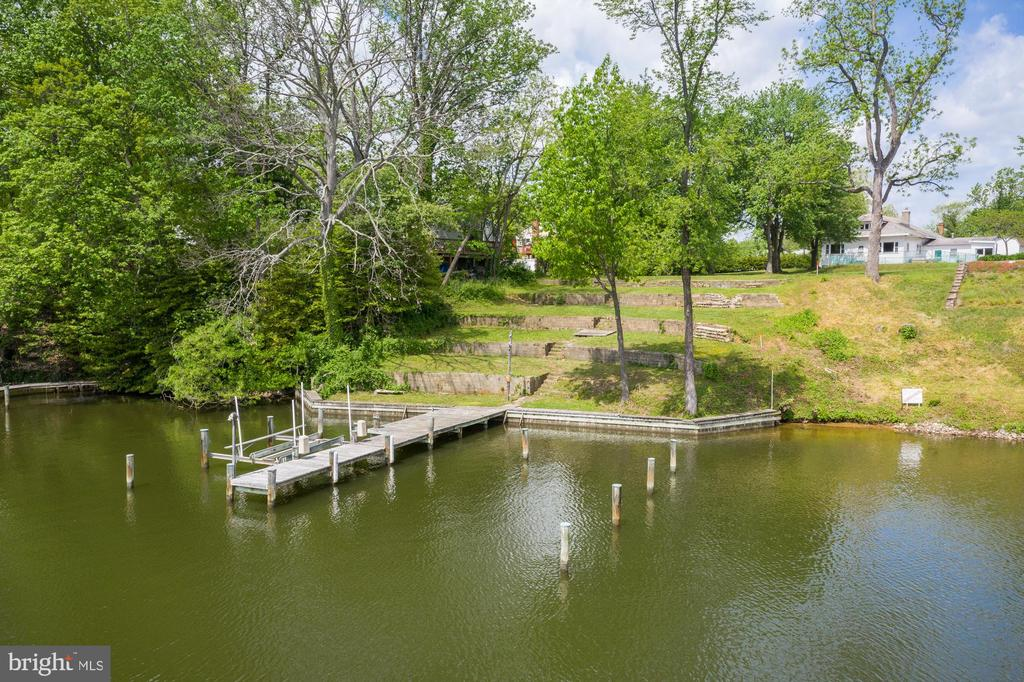 Build your dream home on this fabulous,  .7 acre,  deep water lot, over 100' of water frontage, public water and sewer on-site. existing  multi-slip perpendicular pier with boat lift and 10 ft MLW.   Existing home will be torn-down prior to settlement.  Recorded  plat allows for gorgeous views, a coveted waterside pool, and sweeping lawn to the water.   Located on a protected cove at the mouth of the Magothy with quick access to the Chesapeake Bay.  Work with our preferred builder, architect, and engineer, avaialble for consult, or bring your own.  Blue Ribbon Broadneck schools and close to commuter routes.  MUST SEE!!! Call LA before walking the property, DO NOT ENTER the vacated home.