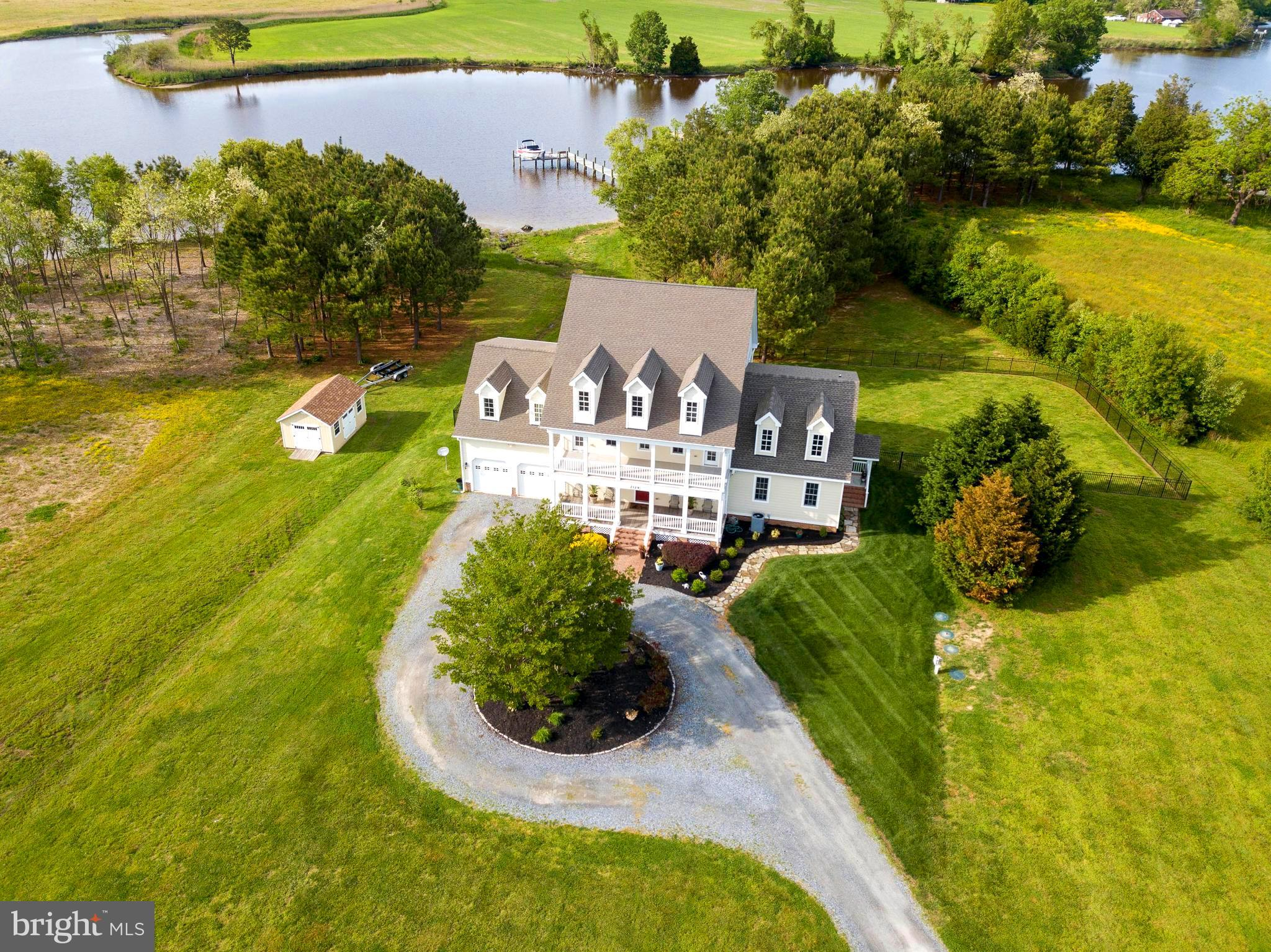 Welcome to the Shore!  Beautifully appointed 5 BR, 4.5BA Waterfront Home on 2.33 acres with pier/boat lift is truly move-in ready.  Home was updated in 2019 with  an in-law suite or primary bedroom on the first floor,  gas fireplace, full bath, screened waterfront porch and deck.  The second floor has 4 spacious bedrooms, one being the second floor primary bedroom, with waterside balcony, primary bath, with jet tub, separate shower and walk-in closet.  Two second floor bedrooms have balcony access overlooking freshly planted farmland.  This home has ample storage on both the second and third floors, with permanent stairway for safe and easy access.   Given its location, you have easy access to all your water sport activities, as well as, a short drive to all in-town amenities!  Whether it's your permanent home or 2nd home, this home will accommodate all your lifestyle needs!  Come enjoy the lifestyle of the Shore, you won't regret it!