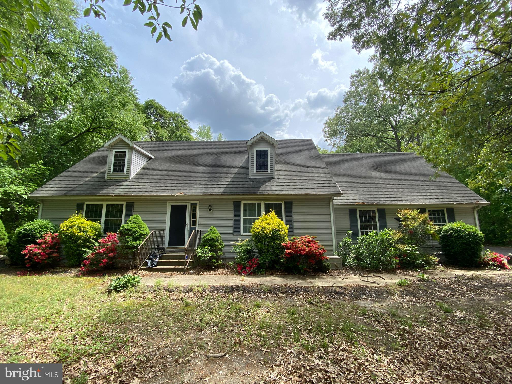 Nice 3 bedroom cape cod on wooded country acre lot! Fresh paint & flooring! All appliances included! Attached 2 car garage & fenced backyyard! Relax on the big back deck & enjoy the rustic seclusion! Make Offers!