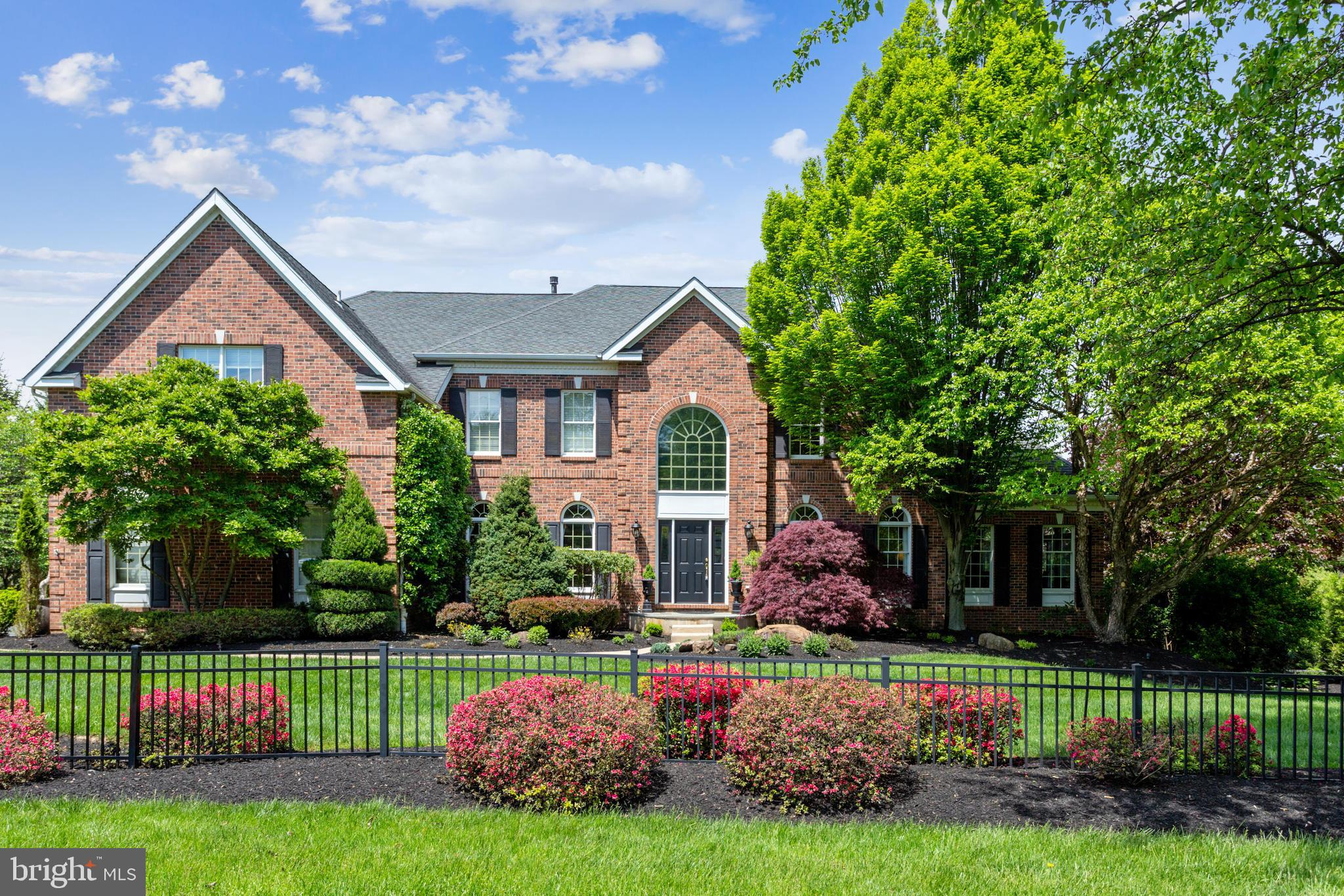 Welcome to 2055 White Horse Road, part of the popular Berwyn Estates community, a brick-front traditional colonial with great curb appeal. Berwyn Estates is in the top-rated Tredyffrin Easttown School District and is within walking distance to the new Episcopal Academy. This light, bright home is configured with the primary bedroom with tray ceiling, sitting room, and en suite bathroom with double vanities, jacuzzi tub and large shower as well as the not-to-be-missed walk-in closet with custom organizer. The guest room with en suite bathroom, plus, two more bedrooms served by a jack & jill bathroom all on the upper level with front and back stairs for access. The main level is complete with a gracious living room and dining room and the sports enthusiast's step-down conservatory with vaulted ceiling. There is also a dedicated office with French doors, the beautiful kitchen with white cabinets, black granite countertops, stainless steel appliances, gas cooking, and the corner window feature behind the sink. The breakfast area leads to the spectacular 2-story family room with floor to ceiling stone fireplace and a wall of windows. The first floor is completed by the laundry room, a powder room, and of course the oversize 3-car garage. The daylight, walkout lower level has the 5th bedroom and 4th full bathroom along with a kitchenette adjacent to the TV/rec room area, followed by a sound-proof media room and exercise room. All of this leading out back to the spectacular outdoor patio living space surrounding the pool and koi pond. As you tour this home, don't miss the numerous upgrades including paver front walkway, Brazilian Cherry hardwood floors through a large part of the main level, crown moldings, bay window in the dining room, large deck overlooking the stamped concrete patio & pool lounging area, as well as three separate HVAC systems. All of this and just minutes to Paoli restaurants, shops, and the train station for the R5 to Philadelphia as well as a short d