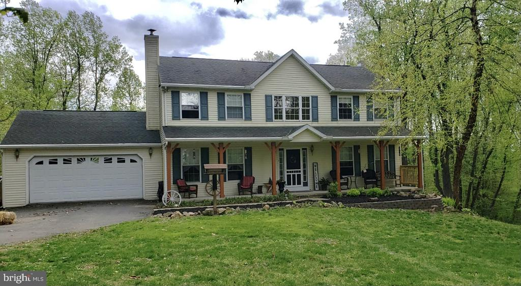 Just Listed!  Showings to begin Saturday, May 15th.  Owners hate to leave this home, but a job relocation is required.  Looking for a rural setting?,..yet close to everything, than this is the home you have been looking for! This 4 BR, 3.5 BA home is nestled on 4.39 Acres has  been completely updated...do nothing but move in.  New deck, new flooring, new granite countertops in kitchen, new pellet stove and mantle in the Living Room,  New Water Filtration System and New HVAC Unit... Enter the home into the 2-Story Foyer and the 1st floor boasts a Dining Room, Oversized Kitchen Area with sliders to the new deck, Main Floor Laundry, 1/2 Bath and a Living Room with a new Pellet Stove/complete with a new chimney. The 2nd Floor offers 3 Bedrooms and the Master Bedroom  features a walk-in closet and master bathroom with a stall shower/soaking tub . The walk-out basement has bedroom #4,  a Full Bathroom and a Family Room with a propane stove.  You will fall in love with the setting  of this home! This one will not last long!