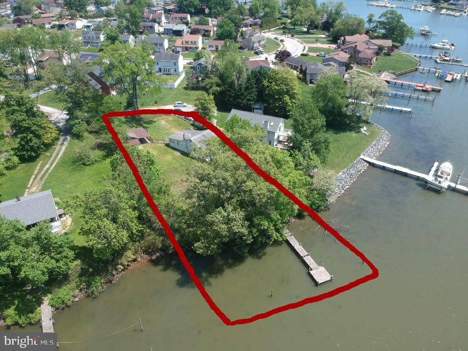 Spectacular waterfront lot nestled in quiet Sue Creek. Spacious  .47 acre lot with 125'+- of shoreline water frontage with fantastic boat access. This rare lot offers a beautiful sunset view overlooking protected and conserved land across the creek.   Property features public water and sewer, and home site area is not in a  flood plain. Property never flooded during Isabelle.  Seller is in process of obtaining permits for new rip rap and pier, environmental permits, demo, and new home building permit for house to accommodate up to 3500 square foot home.  Existing structures to be removed early June. This is a rare opportunity to custom build your dream home on one of the last direct waterfront lots in the area. Current house in in poor condition. Property is also listed as a lot.
