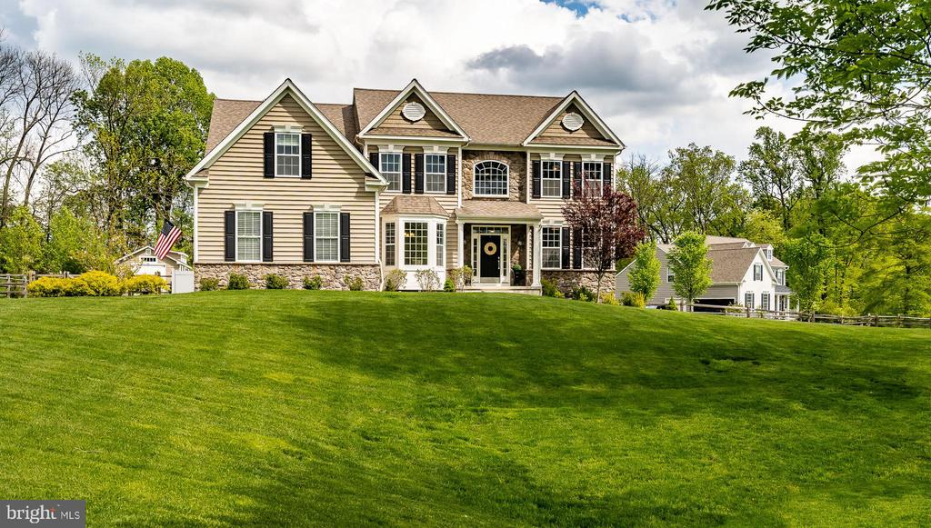 The home will be live on May 14th. Best and Final Offers are due Monday, May 17th by 9 AM. Seller would prefer a 30-day settlement and a rent back through June 30th.  In the prestigious community of Hideaway Farms, this stunning home has all the indulgent features of a luxurious lifestyle.  From the 1.8+ acres of its lush green, manicured lawn to the inground swimming pool to the spacious 3,800+ sq ft interior filled with upgrades, no detail has been overlooked.  Its gracious, covered front entry is flanked by stone accents.  The two-story, hardwood foyer opens to a formal dining room spacious enough to seat a large dinner party.  Crown molding, chair rail, and bay window are appealing extra touches.  The brightly lit formal living room opposite the dining area affords lovely tree views from large windows facing two sides.  The open concept kitchen, breakfast room, and family room combine seamlessly to create a living space that is as welcoming as it is functional and beautiful.  Hardwood floors, granite counters, tile backsplash, recessed lighting, a center island with barstool seating, built-in double oven, microwave, dishwasher, and smooth cooktop range - all stainless steel, built-in desk, and plentiful cabinets throughout, make this kitchen a chef's dream and sure to be the very heart of this home.  Watch a new day dawning from the breakfast table through double glass sliding doors or let the day fade into the evening from the comfort and coziness of the family room by the fireplace.  The thoughtful features only continue - the main floor office makes work-from-home so convenient for the busy professional.  A large mudroom, with sink, closets, cabinets, and coat hooks keep outerwear in its place and backpacks neatly stowed away.  A downstairs powder room completes the main level.  Upstairs, another whole level of comfort is found across five bedrooms, two baths, and a conveniently accessible laundry closet.  The primary suite is a luxury retreat unto itself, wi