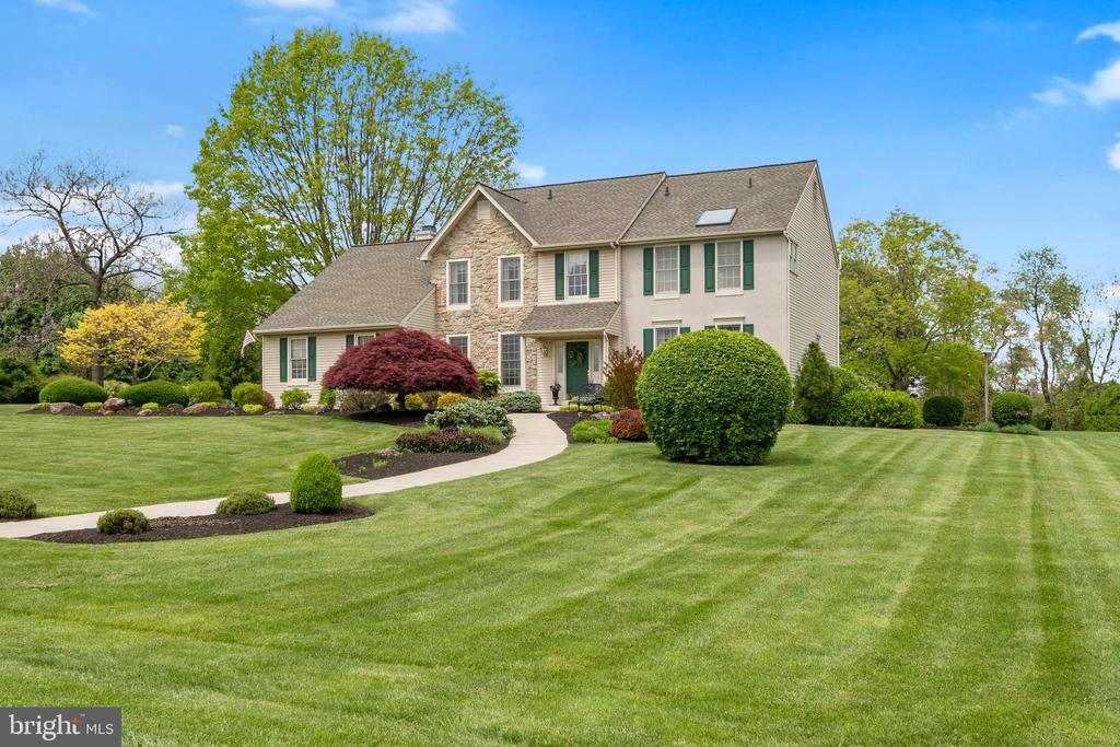 This gorgeous Glenmoore  home with immense curb appeal is a beauty from every angle. Spread out and enjoy 2 gently sloping,  peaceful acres that back up to the wide open space and gentle ponds of Wagenseller Park hidden by a graceful tree line.  Less than 2 miles away is the historical 300 acre Springton Manor Farm with more walking trails and agricultural attractions. Marsh Creek State Park with hiking, boating an many other on the water activities is only 15 minutes away.  The rooms are grand and the large owners suite bathroom could take your breath away with vaulted ceiling , skylight, large jetted tub and 4x3 shower.  Tall ceilings accented by elegant crown molding  in many rooms and picture frame molding on the walls in the living room, dining room and foyer add an upscale look in easy to live in spaces.  The cook friendly kitchen provides lots of solid surface countertops and an island to work making food preparation a breeze. Plenty of natural light streams through the crankout casement windows with half round glass top above the sink looking out over the terrace.  The great room ceiling soars to the second floor with an overlook from the hallway above.  The easy to use propane fueled fire place makes cool nights cozy and the the ceiling fan gently circulates the air for all season comfort.  The generous deck and patio area are nicely landscaped ready to host fabulous outdoor entertaining and the entire property is very well groomed to impress.  This home deserves the dramatic aerial pictures and high end 360 degree virtual video tour that we did to showcase everything it has to offer so that you can get an amazing sense of what your life could be like here. There are so many highlights.  The sellers have enjoyed this home since 1999 and have taken good care of it along the way. The roof was replaced in 2017 with 30 year Timberline Architectural Shingles, The HVAC was replaced in 2006 with a regularly serviced and very dependable Trane Heat Pump. There is a 