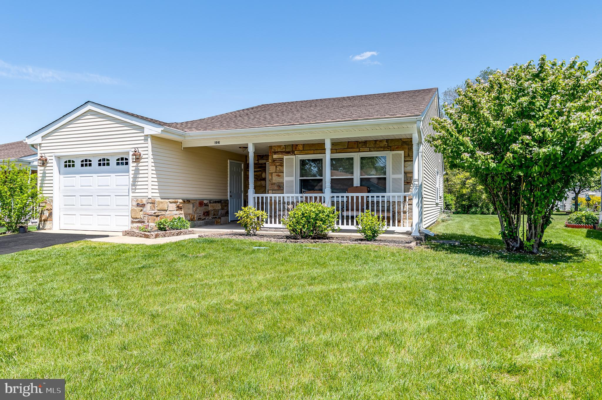 This well-maintained, move-in ready Haverford model has many features and upgrades that make it very desirable. There is a newer Dimensional Shingle Roof, that has a 50-year transferable warranty, a newer 50 Gal Water Heater, and a York AC system.    The property has a Rain Bird Sprinkler System.  All mechanical systems have been maintained annually. The home has been inspected annually for wood-destroying insects and has a clear termite certification. How's that for starters??  Add to that, the covered porch with white railings and the Pella storm door that has mini blinds built in so you can adjust the light exposure into the home. The large living room offers flexibility for entertaining, especially with a half wall dividing the living room and dining room. Crown molding in both rooms and the hall complements the space. There is laminate flooring in the foyer, living room, dining room, hallway and kitchen.  The expanded eat-in kitchen can easily accommodate a large table, or an island, if you prefer. The kitchen has warm honey cabinets with brushed nickel hardware that matches the stainless steel appliances. The granite countertop has an upgraded leather finish that is stunning to the eye and touch. There is a stainless steel double sink and a Moen touchless faucet. A built-in pantry and shelving also add to the functionality of this room. The back door, also Pella with mini blinds, leads from the kitchen to a concrete patio that has an electronic, remote-controlled, Sunesta Awning.  In addition to providing relief from the sun when sitting on the patio, it also reduces the heat from the sun coming into the kitchen. The Primary Bedroom has a walk-in closet and new carpeting. The attached full bath has an enlarged walk-in shower for ease getting in and out of the shower. The Second Bedroom, which can be used as a guest room, an office or a craft room has new carpeting and two wide floor-to-ceiling closets which provide lots of storage. The leather-finish granite t