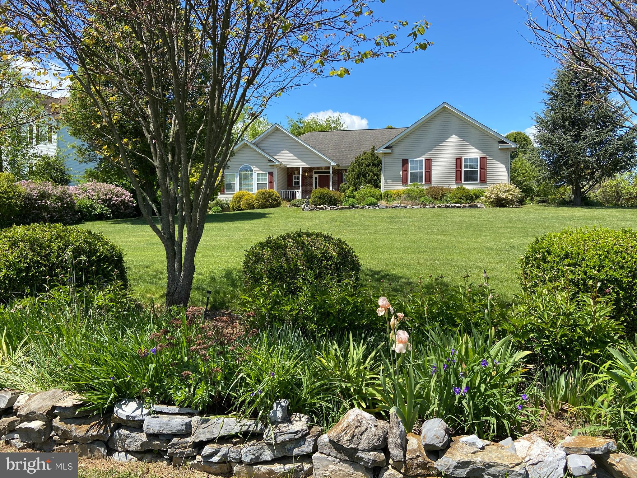 MOTIVATED SELLERS. $15000 price reduction. Ranchers are sure hard to come by,  so don't let this one go by!  Main level living offers 3 bedrooms but a 4th/office/den/br if desired. Family room has a stone gas fireplace and is open to dining and kitchen area for easy entertaining!  Large kitchen offers plenty of cabinets. Full, unfinished basement has many possibilities with full bathroom room already installed.  Master bath has double sinks, sep. shower, soaking tub and walkin closets. Deck plus a covered front porch and extra large sunroom.  If you love landscaping and flowers, this is a master gardners dream. Hundreds of periennals surround the yard edges. Yard art will not convey. THIS PROPERTY  IS PRICED TO BE BE SOLD AS IS.