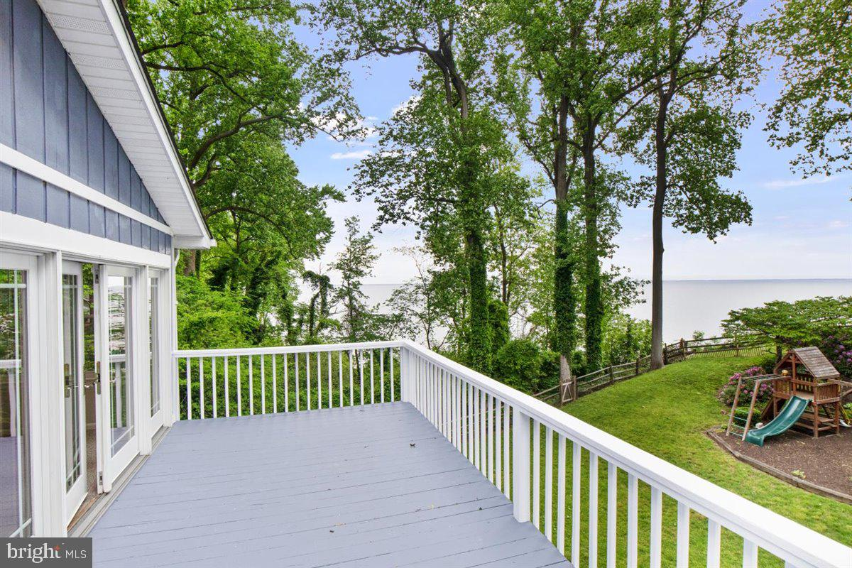 Vacation at home!  Lovely Chesapeake Bay Waterfront home  with three finished levels!  Walk in the front door to views of the Bay.  Gorgeous Brazilian Rosewood flooring on the entire main level.  The kitchen features loads and loads of cabinetry and stainless appliances.  Big screened porch off the kitchen area affords you the perfect place to eat crabs  or watch the sunrise .  Go up the wood spiral staircase to the upper bedroom level featuring 3 bedrooms and great room with gorgeous views! Owners suite has a full upgraded bath.  The other bedrooms share a half bath.  More expansive views from the great room upstairs as well as balcony overlooking the yard and the water.  The lower level has another full bath, a den/study/bedroom and a large laundry room.  Walk out level with access to parking.  Lots of updates throughout the house makes it move in ready.  Walk out to the water from your yard and you will find a large deck with perfect expansive views of the Chesapeake Bay.  Please to not go outside of the rope line for your safety.  There is a private beach partially owned by this property Tax Id:  0503253110 which conveys with purchase.  Many recent updates are included in document section for easy viewing.  You can have all of this and you are only about one hour away from Washington DC!  Come see the superb views, sunrises over the Chesapeake Bay and the peace and quiet of beautiful Calvert County.  You are only a couple of miles away from The Chesapeake Bay Resort, water park, North Beach Board Walk and lots of restaurants and farmers markets for your enjoyment.