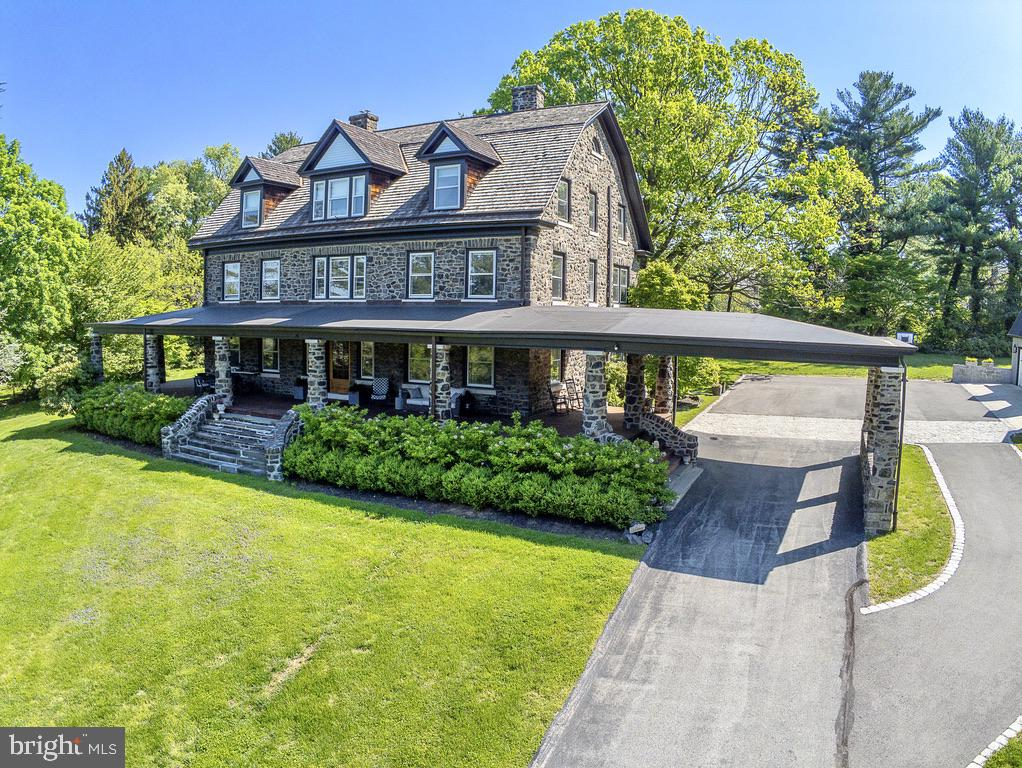 Welcome to this stunning and historic stone manor home set on a 3+ acre property in coveted Gladwyne.  Enter the long drive, through gated stone pillars, and arrive at the courtyard with covered entrance and impressive wrap around covered porch with views of the lush landscaping and extensive lawn and gardens that encircle and frame the property.  This architecturally distinctive home has been beautifully maintained and updated to meet the needs of today's lifestyle while preserving the classic quality and character of the period.  All rooms are spacious and open, with wide hallways and  staircases connecting three full living levels.  Visitors are welcomed into the stunning Grand Foyer that opens into many directions. The Main floor offers a Living Room, a very spacious Family Room with fireplace, completely redesigned and renovated Kitchen with eating area, original Butlers Pantry with vintage cabinetry, Dining Room with fireplace,  a new full Bath with shower, and oversized windows in every room bringing in wonderful natural light.  The grand staircase leads to the 2nd floor with 5 spacious bedrooms and 3 stunning new baths.  The Master Bedroom features an exquisite new Master Bath, custom designed with the highest quality materials and fixtures. The Laundry Room is also located on the 2nd floor.  The Open staircase continues to the 3rd living level with additional Bedrooms, an office, a playroom, and an upstairs Family Room, all served by a hall bath.  A huge walk in closet on this floor provides ample storage.  The distinctive architectural features that define this home continue throughout all three floors, with beautiful hardwood floors, deep window sills and large windongws, and living space designed on a grand scale.  The basement is very spacious and features an outside daylight entrance into the mudroom, organized with cubbies and storage for everyday use, and featuring a double set tub sink and full bath with shower.  The detached 3 car oversized garage features a loft room ready to be finished into a gym, party room, basketball court.  It is electrified, has 3 ceiling fans, and the garage is plumbed for a bath.  This estate home offers an environment steeped in tradition and history but updated with all the amenities for today's lifestyle. Enjoy the beauty of the land, the convenience of the location, and the distinction of living in one of the Main Line's most desirable neighborhoods, rich in history, educational opportunities, and living reminders of its notable past.