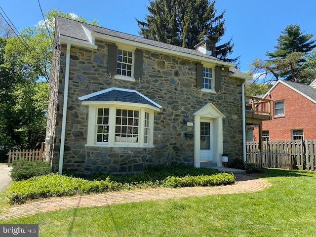 This adorable Pennsylvania Fieldstone Colonial house is perfectly located on a quiet street in a very desirable part of Devon, waiting for your family to call it home. The home has been freshly painted and is light bright with wood floors throughout. Enter into the living room with a wood burning fireplace and upgraded custom wood mantel with glass doors. The living room is centralized to both the large formal dining room with bay window on one side, family and powder room on the other side. The kitchen hosts newer cabinets with a pantry of cabinets alongside the one side of the refrigerator.  Located on the lower level is laundry and plenty of storage. Upstairs has three well sized bedrooms, one with a door leading to a second-floor deck, and a hall bath. The deep back yard is fenced has a deck off the kitchen, shed, patio, and covered porch. With award winning T/E Schools, easy access to 202, 76 and Schuykill Expressway, close to train, shopping, Valley Forge, and don't forget Handel's Ice cream shop.