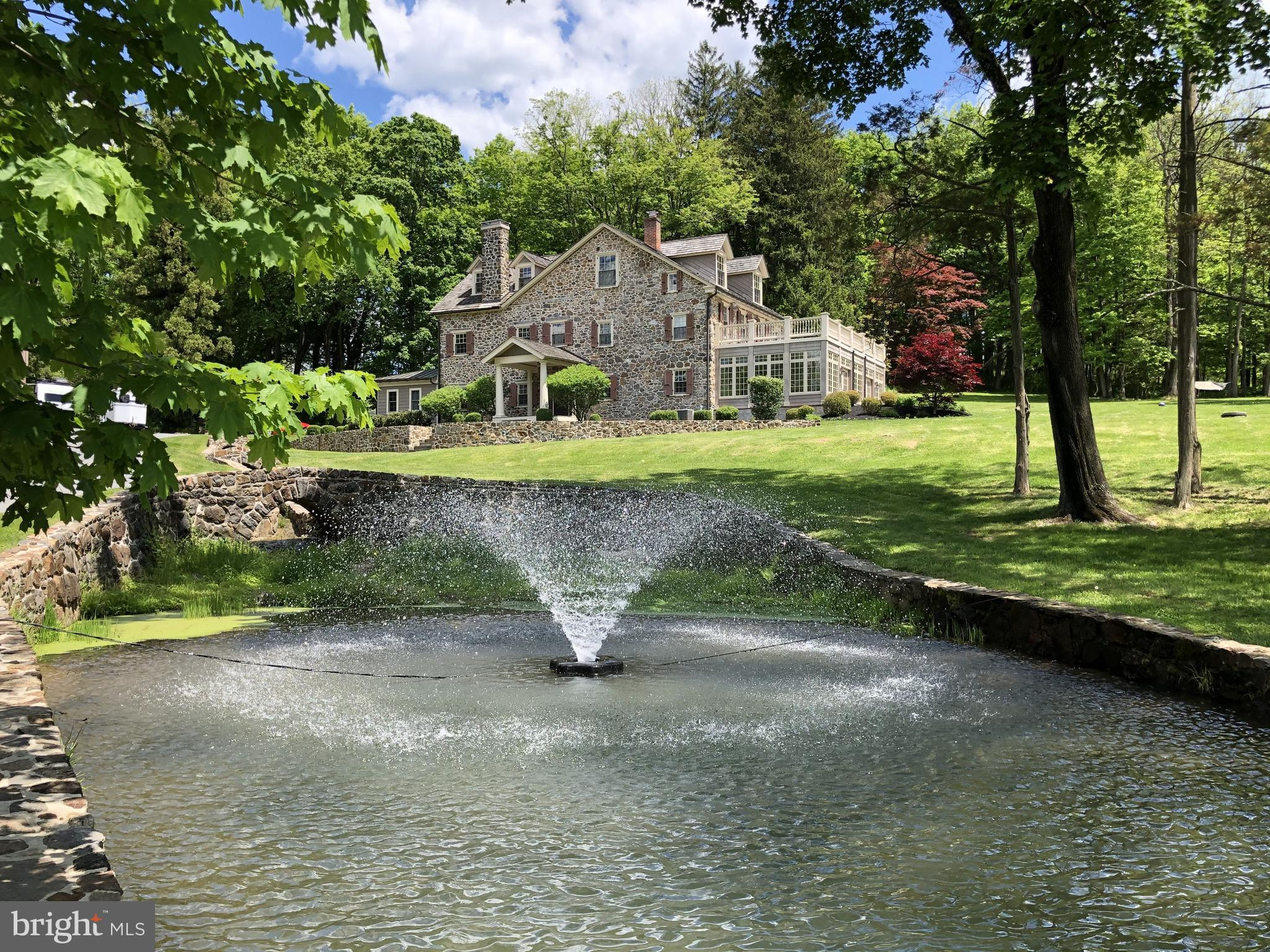 Beautifully restored 5BR field stone manor house sensitively positioned, with the landscape, on 8.5+/- acres.  Lovely stone pillars and walls surrounding the pond as you enter the property.  Small spring fed stream originates from springhouse on the property.  Bank barn, fenced pasture, round pen - stalls and loafing shed.  Property offers views for miles!  Call for Showing.