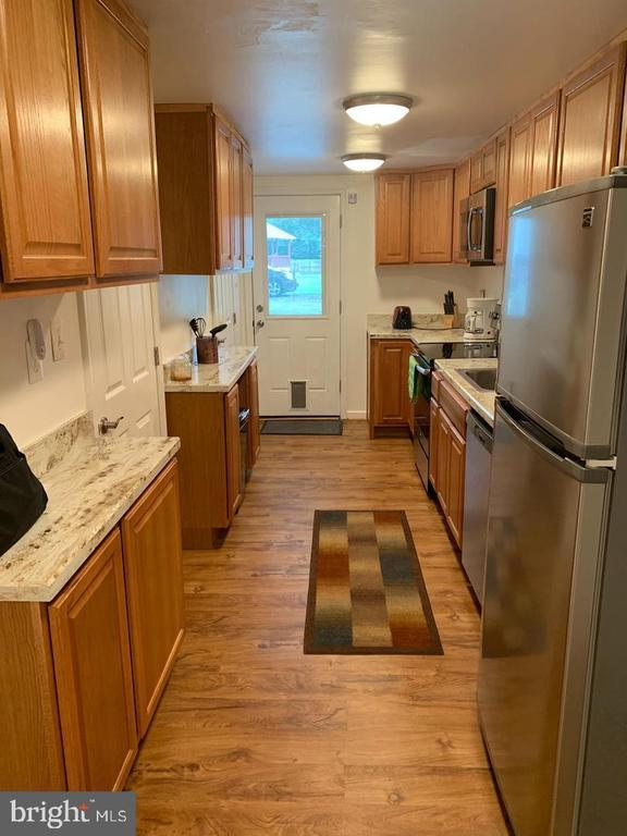 Have someone else pay your mortgage! Golden opportunity awaits the smart buyer who buys this detached home that consists of two units. Live in one side and rent the other.  Unit B has a tenant now!  Low interest rates make this a great time to start owning real estate.  The owner renovated both units and they show so well that there hasn't been a problem keeping the units rented.  Unit B was the last unit to be renovated. It has one bedroom, a bonus room that's been used as a dining room, a full and half bath and wood burning fireplace.   Unit A  has one bedroom, an eat-in kitchen and a living room with a wood burning fireplace.  Both units have the ductless heating and air conditioning systems that are efficient and quiet.  They each have washer and dryers in utility rooms.   Outside, there's a large backyard with a shed.  In each unit, the kitchens have doors to the backyards. The owner has lead paint free certificates and rental licenses for each unit.