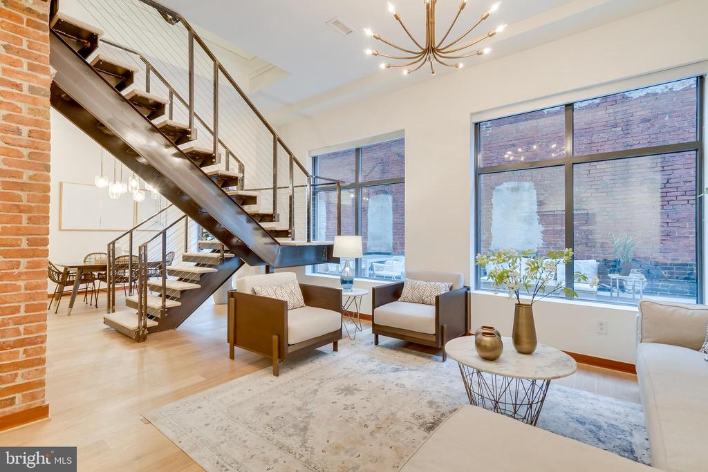 2 Level Condo at Cooper Lewis | 2 Bed | 2.5 Bath | 1,450 Sf | 450 Sf Terrace | 1 Parking Space | 1 Large Storage Unit | Building: Boutique Building, 18 Units, Elevator, Built in 2006, Underground Garage, Bike Storage Room | Unit: Floor-to-Ceiling Windows in Living Spaces, Separate Living Room & Dining Room, Powder Room w/ Red Ravel Jasper Marble Flooring, Large Walk-In Closet in Primary Suite, Custom Built-in Storage System in Closets, Recessed & Track Lighting Throughout, Custom Roller Shades, Exposed Brick Walls, 12 Ft. Ceilings, New European White Oak Hardwood Flooring, Large Storage Unit w/ Shelving | Kitchen: Kitchen Island w/ Seating for 3, Scavolini Custom Built-In Cabinetry, New Soapstone Countertops & Backsplash, Kitchen Aide - Architect Series Stainless Steel Appliances, Gas Cooktop w/ Axia Hood | Baths: Dual Vanity w/ Storage in Primary Suite, Limestone Tiling in Primary Suite, Frameless Glass Shower Enclosure in 2nd Suite w/ Carrera Marble, Scavolini Cherry Vanities w/ Storage, Duravit Vessel Sinks, Hans Grohe Fixtures, Full Sized Tub, Toto Toilets