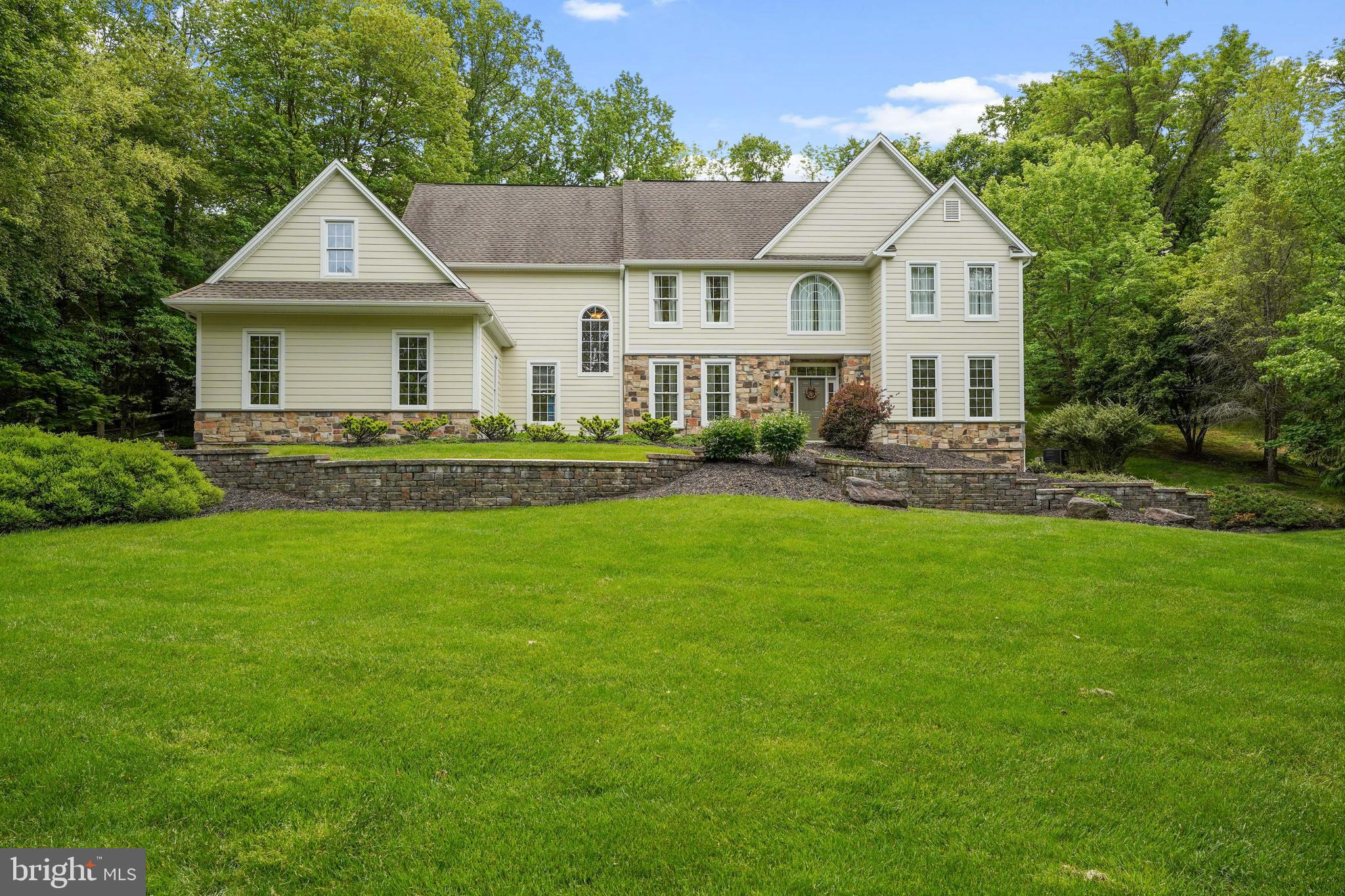 Welcome to 1017 Ballintree Lane, an awesome, classic  5 bedroom 4.5 bath home with fabulous landscaping and an incredible pool!  Nestled in the popular neighborhood of Courts at Longwood this attractive home has been lovingly maintained by its current owner.  From the gleaming hardwoods in the entry hall and throughout the sun-lit first floor you will feel the spacious and welcoming vibe of this lovely home.  The home features an updated kitchen with beautiful wood cabinetry, granite countertops and large island - which opens onto the beautiful, cozy family room, complete with stone gas fireplace and attractive built ins!  There are elegant formal dining room and living room spaces as well as a large, quiet office space and first floor laundry.  Amazing 3 bay garage with lots of storage besides.  The show stopper and focal point for entertaining and enjoyment of this home is the amazing patio and pool area , complete with hot tub and waterfall! This home has all five bedrooms on the second floor, one bedroom with an en suite and the primary bedroom with  an expansive, neutral primary bath and walk in closet.  Lower level features a finished walk-out basement with additional office space.  Courts at Longwood is a convenient community great for walks around the pond and nearby walking trails as well as bike rides .  This home is in the award -winning Unionville Chadds-Ford School District and  convenient to the fun shops and restaurants of both Kennett Square and West Chester.  Close to  Longwood Gardens,  Brandywine River Museum, Galer Winery and many other local attractions.