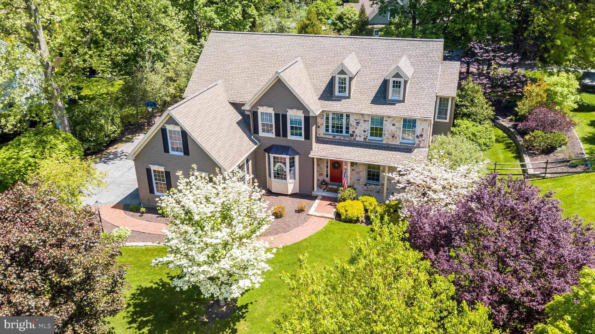 Welcome to 600 Perry Drive that is located in the desirable Wiltshire neighborhood which is an enclave of 11 homes and it is just minutes away from downtown West Chester Borough, West Chester Country Club, major routes, and it is also located in the brand new Greystone Elementary School zone. This attractive move-in ready home sits on a corner lot, with extensive landscaping and hardscaping- lots of room to entertain and enjoy! Enter from the brick walkway to the expansive foyer highlighting site finished hardwood floors throughout the main level, impressive moldings and lots of natural light. This home screams attention to detail! To the right you will find the formal living room with large windows, crown molding and access through glass french doors to the first floor study. The study could have many uses such as a studio/den or other. The formal dining room is impressive with its wainscoting, curved wall of windows, chandelier and access to a butlers pantry and kitchen. The kitchen features custom cabinetry with gas cooktop and double ovens, upgraded tiled backsplash and vent hood, stainless appliances and a large two-toned center island. The breakfast bar overlooks the breakfast room with vaulted ceilings, walls of windows and glass doors to the rear patio. The family room is open to the kitchen and breakfast room and features transom windows, vaulted ceilings, recessed lighting, attractive gas stone fireplace and views of your private yard and landscaping. A large mudroom/drop zone area with tiled flooring and large closet is located from the side door entry and garage, the perfect area for backpacks, muddy boots and the like! This area also accesses the second staircase leading to the bedroom level. A powder room finishes the main level. Up the hardwood tread stairs to the bedroom level, the master bedroom offers a sitting room with double doors, vaulted ceilings, natural tones, chandelier and walk-in closet with built-in closet organizers. The master bath off