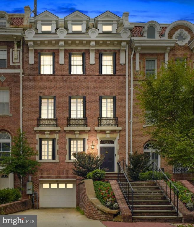 Distinguished Kalorama residence, featuring grand proportions & period details tastefully blended w/contemporary touches.  Appointments incl Double Liv Rm w/ 2 Fpl, Formal Din Rm leading to patio, Modern Kit w/ SS Appls, custom Cab, Fin Bsmt. 2nd FLR dedicated owner's suite w/luxury Ba, walk-in closet, sitting Rm. Add'l 3 BRs/3.2 Ba, plus top FLR 2 office suites w/monument views! Garage PKG+1. 95 walking score!