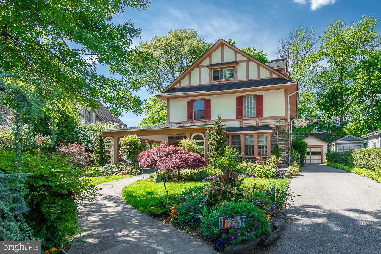 Enjoy the vibrant spring blooms surrounding the inviting wrap around porch of this beautiful 5 bedroom, 3 full and 1 half bath, 3-story Colonial in Bala Cynwyd.  You will immediately notice the old world charm of this home as you enter the large foyer with dark hardwood floors and open stair case.  The formal living room features exposed beams, crown molding, recessed lighting and wood-burning, stone fireplace.  The formal dining room, currently used as a den, is just off the kitchen and boasts recessed lighting and wainscoting.  Oversized eat-in kitchen has island, granite countertops, vaulted ceilings with skylights and sliders to large back patio perfect for dining al fresco.  Conveniently located half bath, laundry and back stairs complete the first floor.  Ascend the stairs to the second floor where you will find the primary bedroom suite with gorgeous renovated bath featuring double vanity,  walk-in shower and tons of closets, as well as two additional bedrooms and full hall bath.  Third floor with two sizeable bedrooms and full hall bath.  Finished lower level with 3 separate rooms offers options for playroom, gym, office and storage.  Brand new roof, 2 zone heating, exterior sprinkler system.  Award winning Lower Merion Schools.  Easy access to Center City and close to schools, parks, shops and restaurants!