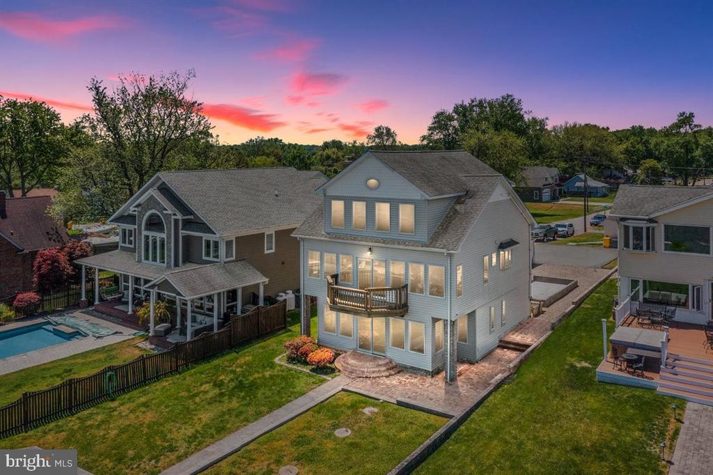 Welcome Home!  2236 Lake Drive is located on the Chesapeake Bay with your own 90 foot private pier, when on a clear day you can see both the Chesapeake Bay Bridge and the Key Bridge.  Your new home offers stunning views of the Chesapeake Bay  from  3/4 of the windows in the house.  There is a 10,000 boat lift with remote and a jet ski lift for the water enthusiasts. Flat Back yard, with patio, makes the perfect spot for a firepit.  A  deck built to hold a hot tub.  Fish cleaning station down by the pier.  The house boasts Hardwood floors, 3 bedrooms and 2 full bathrooms, with a small conversion it could be 4 bedrooms!  There is a whole house generator included. Single Car Garage with entry into the home. Shed with Water and Electric run to it, in the backyard.  Plenty of off street parking for social gatherings.  Community offers tot lots, and public water access.