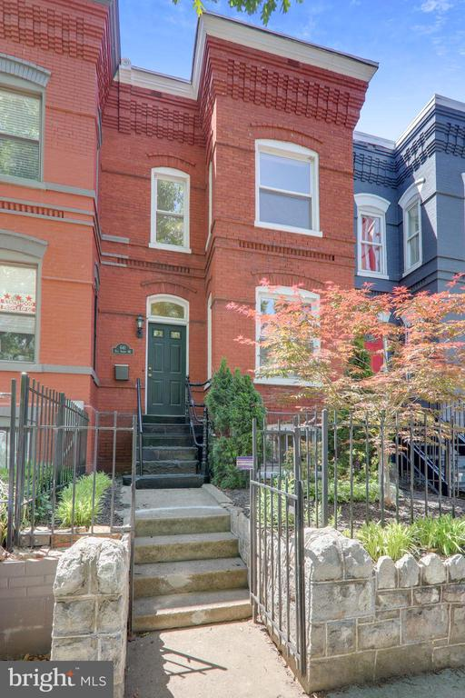 """** GREAT NEW PRICE ADJUSTMENT ** Location x 3! ONE BLOCK from the hot H Street Corridor… AND tree-lined and residential!… Come be part of history in the original """"Old City"""" in the L'Enfant Plan… 1920ish Victorian townhome… perfect blend of yesteryear and today… Most renovations won't give you ORIGINAL red pine floors and charming fireplace mantles… cozy radiators AND new central split-level A/C  … making heating and cooling comfortable and affordable all year long… FIVE BEDROOMS with closets… incredibly spacious owner's suite and TWO updated full baths… tasteful top-down/bottom-up honeycomb blinds throughout with BLACKOUT SHADES in upper bedrooms… EXPOSED BRICK in light-filled kitchen…finished basement with full laundry… landscaped front yard… secluded rear patio… AWESOME VALUE in H Street at approx.  2,100 finished square feet. WALK SCORE OF 98 gets you STEPS from Whole Foods, restaurants, and the trolley stop… down the street from Atlas Theater… blocks from trendy Union Market district… a quick walk to the Union Station TRANSPORTATION HUB with trains and buses to everywhere!!... Leave your car behind for Capitol and Mall events and take advantage of living in the HEART OF THE NATION'S CAPITAL! While in great condition, and all pre-inspections welcome, property is being sold """"as is."""" Owner/Agent."""