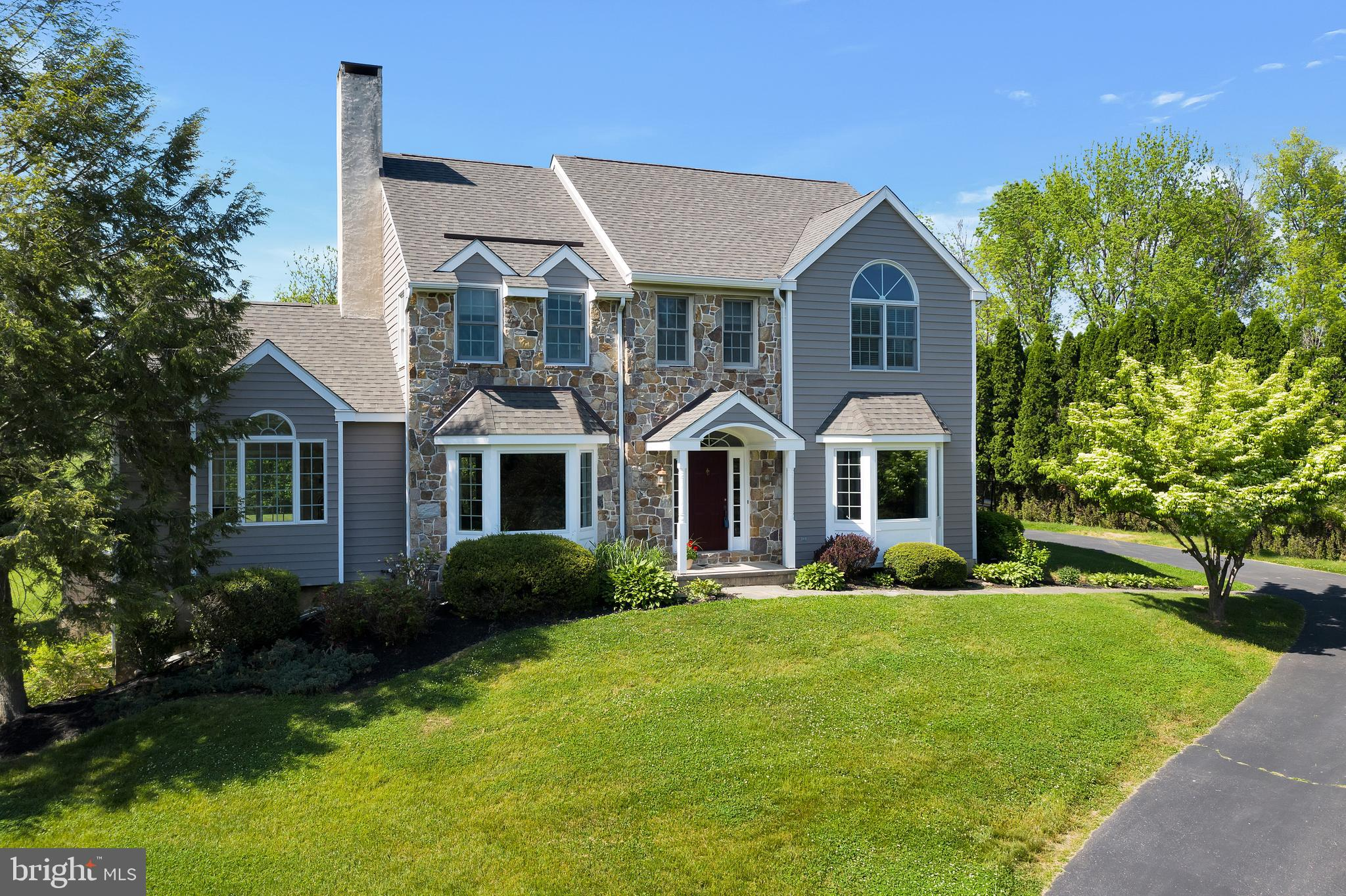 Welcome to 1243 White Wood Way, a gorgeous, well-maintained, traditional-style home that sits on a stunning, private, flat 1.3-acre lot in the Regalwood neighborhood. This home is located in the award-winning Unionville Chadds Ford school district. Upon entering the home, you will notice the grand 2 story foyer with site-finished hardwood flooring that flows into the dining room. There is a large office/ living room with beautiful french doors and new carpeting. The spacious dining room is open to both the kitchen and family room. The dining room features custom crown molding, wainscoting, and a big bay window that lets the natural light flow in the room. The sizable eat-in kitchen offers plenty of counter space for cooking and entertaining! It features beautiful Brazilian cherry hardwood floors, a big kitchen island, a walk-in pantry, and a sliding glass door that leads to the backyard! The kitchen is open to the family room that has ample natural light from the wall of windows and sliding glass doors! The family room has an impressive stone wood-burning fireplace and new carpeting! Finishing off the first floor is an oversized laundry room with cabinets, a sink,  and plenty of storage space. The powder room is off the mudroom area. The upstairs offers new carpet in the hall, 4 sizable bedrooms, and an oversized hall bath with double sinks. The spacious primary bedroom offers an ensuite spa-like bathroom and walk-in closet. The finished walk-out basement has endless possibilities! The basement features a sitting room with gas burning fireplace, a playroom, an office, a bedroom, and a full bathroom. This is the perfect space for out-of-town guests, in-laws' suite, or an au pair suite. This home is triple E rated for efficiency. Most windows, sliders, and French doors have been replaced in the last 5 years with Anderson 400 Series, low E, new construction windows, and doors. The roof was replaced in November of 2020 with 50-year architectural shingles. Most exterior 