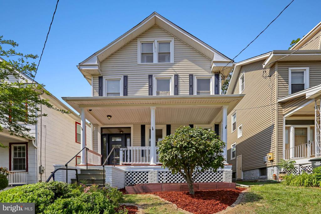 Perched above the street on a 5,000 square foot lot on a quiet and tree-lined block this stately and updated four level Victorian home with southern exposure boasts an ideal Brookland location. A wide array of popular and authentic restaurants awaits just one half block away on 12th Street, including Brookland's Finest, Primrose, and many more, as well as those everyday conveniences like Yes! Organic Market and CVS. Venture just a few more blocks to the Brookland Metro and the immediately surrounding area with its abundance of restaurants, bars, parks, shopping and neighborhood hangouts. Brookland is full of history, beauty and things to explore, and 1254 Hamlin Street is a perfect starting point for any outing.   Ascending the front steps leads to a wide and gracious front porch running the full width of the home - a perfect location to watch the sunrise and sunset while gazing over the neighborhood. Beyond the beautiful front door, the formal entry is an elegant greeting point for the open and impressive first floor with its high ceilings, hardwood floors, multitude of windows bringing natural light into the living spaces, including large living and dining areas perfect for entertaining and larger dinner parties, a stainless steel and granite open kitchen with a breakfast bar, and the convenient first floor full bath.  Offering an extension of the already generous interior living spaces, the flat, expansive and fully fenced backyard underwent significant renovations in 2018-2019, and features a natural gas outdoor kitchen and natural gas firepit, and a delightful storage and potting shed, to create a private oasis for grilling, lounging, entertaining and gardening.   Beyond the beautiful first floor wood staircase, the first upper level offers two bedrooms and two updated bathrooms, including the master suite with a full bath featuring a stall shower and soaking tub, as well as convenient second floor laundry. Two additional bedrooms, each of which can also easily