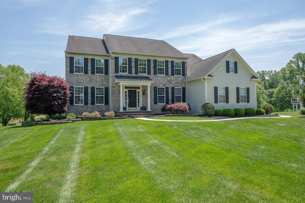 """Stunning Estate home situated on a premium, private 1+ acre lot located in the beautiful community of """"Haverhill Estates"""" in sought after Chester Springs. This tastefully appointed home offers 5 Bedrooms, 4 full Baths and 1 half Bath   over 5,000 sq ft on the 1st and 2nd floors plus 1,200 sq ft of additional living space in the professionally finished walkout Lower Level including Game Room, Media Room, full Wet Bar w/undercounter lighting, Exercise Room, full Bath & plenty of storage. The fabulous Outdoor Living area provides an attractive extension of the main home featuring a beautiful inground saltwater pool & spa, new maintenance free Deck (2018) and inviting paver patio adjacent to the pool. A Complete Exterior Renovation features Hardie-board siding, new soffits and gutters and enhances the home's curb appeal and no-maintenance lifestyle. 1st Floor features beautiful hardwood floors and extensive custom millwork throughout; elegant 2-story entry Foyer with turned staircase, Living Room & Dining Room w/custom millwork & hardwood; private Study w/hardwood, French doors & new wainscoting & chair rail (2019); renovated gourmet Kitchen (2019) & Breakfast Room featuring custom cabinetry w/curved crown molding, large Quartz island, stunning tile backsplash, stainless appliances (GE gas cooktop, double wall oven & French door refrig), recessed lighting, large Pantry and adjacent vaulted Breakfast Room extension w/exit to rear deck; Family Room w/hardwood, coffered ceiling, stone gas fireplace & rear family staircase; Powder Room & convenient Laundry/Mudroom w/hardwood, custom cabinetry & drop-in sink complete the 1st level. 2nd floor offers double door entry to luxury Master Suite w/Sitting Room, vaulted Master Bedroom w/beautiful custom built-ins & dual walk-in closets, Master Bath w/vaulted ceiling, soaking tub, stall shower and separate vanities; 4 additional Family Bedrooms including Princess Suite w/private en-suite Bath, 2 Bedrooms sharing a Jack'n Jill bathroo"""