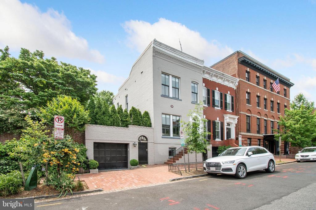 Stunning semi-detached, sun-filled, renovated home in Georgetown's East Village! Kitchen offers updated appliances, modern gas fireplace, and french doors leading to spacious garden. One-car garage parking, fully finished lower level living space. Modern finishes, in-ceiling speakers, throughout the home.