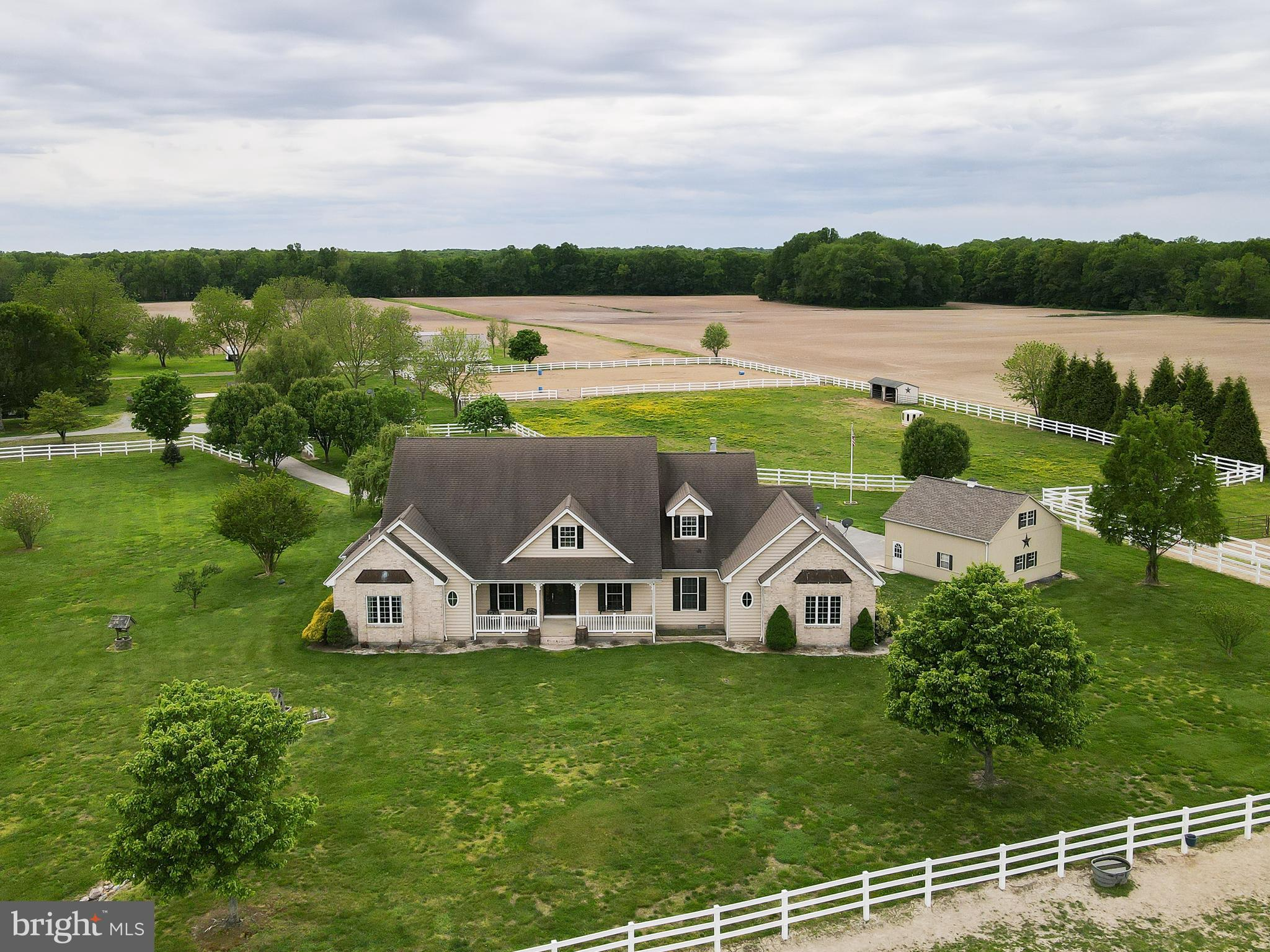"""Bring your horses to this incredible tree lined estate that leads to a beautiful custom Cape Cod & three additional homes on 96 acres. This property is ideal for horses, goose, waterfowl and deer hunting. Bring your small crafts and kayaks with direct access from the property to Saw Mill River. Private dock for fishing or crabbing.   The main home features 4 bedrooms, 2 full bathrooms, main level powder room, covered front porch overlooking pond, 2 enclosed porches and two-tiered rear deck. The gourmet eat-in kitchen has 42"""" cabinets, granite counters, custom wooden backsplash, recently upgraded stainless steel appliances, eat up breakfast bar, and a huge island with electric range and pendant lighting. Additionally there is a private study with built-in shelves, formal dining room, large rec room for entertaining, and spacious living room with hardwood floors, crown molding, built-in shelves, gas fireplace, and glass doors to a cozy sunroom. First floor owner's suite with tray ceiling, recessed lighting, large bay window, walk-in closet, jetted tub, stand-up shower with dual showerheads, double vanity, and water closet. Upper level loft/4th bedroom with roof-top balcony, which is plumbed for the potential to add two additional bed and bath. Oversized detached 2-car garage wired for electric with a floored loft that can be finished into an office.   Additional three rentable homes on property with estimated earning potential around $4,000/mo. Largest rental is a Nanticoke with 3 bed, 2 bath, 2-car detached garage. Second is a manufactured home that sits on permanent foundation with 3 bed, 2 bath, deck, 2-car detached garage. Third rental home is a quaint 1 bed, 1 bath with front & rear porches.   The crown jewel of this listing is the property itself. 40+ tillable acres, 30+/- acres of pasture, and the rest maintained as natural woods and marshland. In addition 100'x200' riding ring, two stocked ponds, and 3 pole barns with largest being 40'x60'. Second 40'x40' wire"""