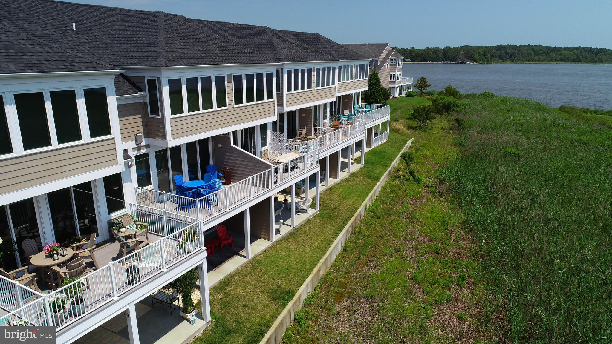 A RARE FIND...GENERATION III, POPULAR COURT FLOORPLAN...the newest building in Bayville Shores. The home features twin master suites (1st and 3rd floors), an en suite guest bedroom on the 3rd floor, a 12' x 17' 2nd floor sun deck, a 12' x 17' covered lanai, Florida room, great room, dining area, gourmet kitchen with granite countertops and breakfast bar and a full array of stainless appliances, undermounted double stainless sink, gas fireplace and media center, 9' ceilings throughout main living areas and 3rd floor master suite, 1st floor wet bar and refrigerator with granite countertops, 1st floor laundry area and one car garage. The home shows better than new and is being sold fully furnished and accessorized.