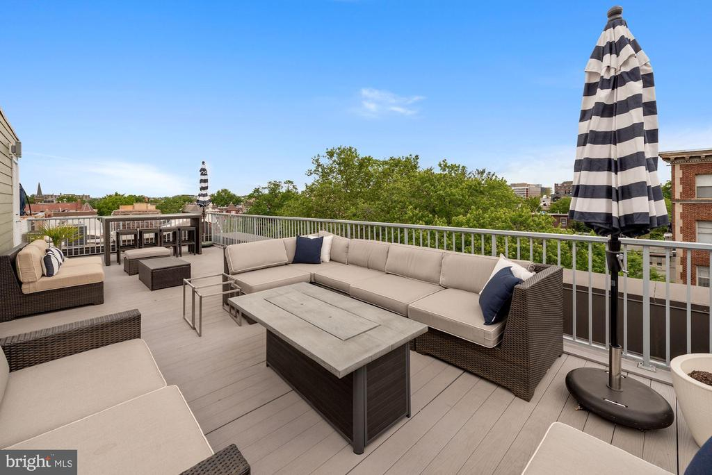 ** Public Open House on Sunday, June 6, 1pm-4pm.  Offers due on Tuesday, June 8th by 12pm**  You've arrived at your chic, stylish, and spacious 2BR, 2.5BA condo in Logan Circle.  There are two levels of well-appointed living space, but the pièce de résistance is the oversized, private rooftop deck on the third floor, which includes room for a fire pit, grilling station, dining area and additional seating while relaxing with friends.  The main level features a line of windows that run its length, streaming natural light into an open concept living/dining room with fireplace and bringing breakfast-with-a-view on a sunny morning to a whole other level.  The residence's multiple windows and two skylights on its second level channel sunlight seamlessly throughout its rooms and baths.  Both bedrooms are en-suite and have been beautifully updated with sleek finishes.  This condo has it all as it is a pet-friendly, has a low condo fee, and is ideally located in the Logan Circle Neighborhood close to 14th St & P St restaurants, shops, Whole Foods, U St and Metros.